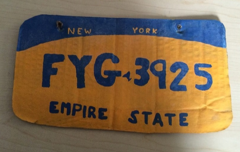 Fake license plate made of cardboard and paint.