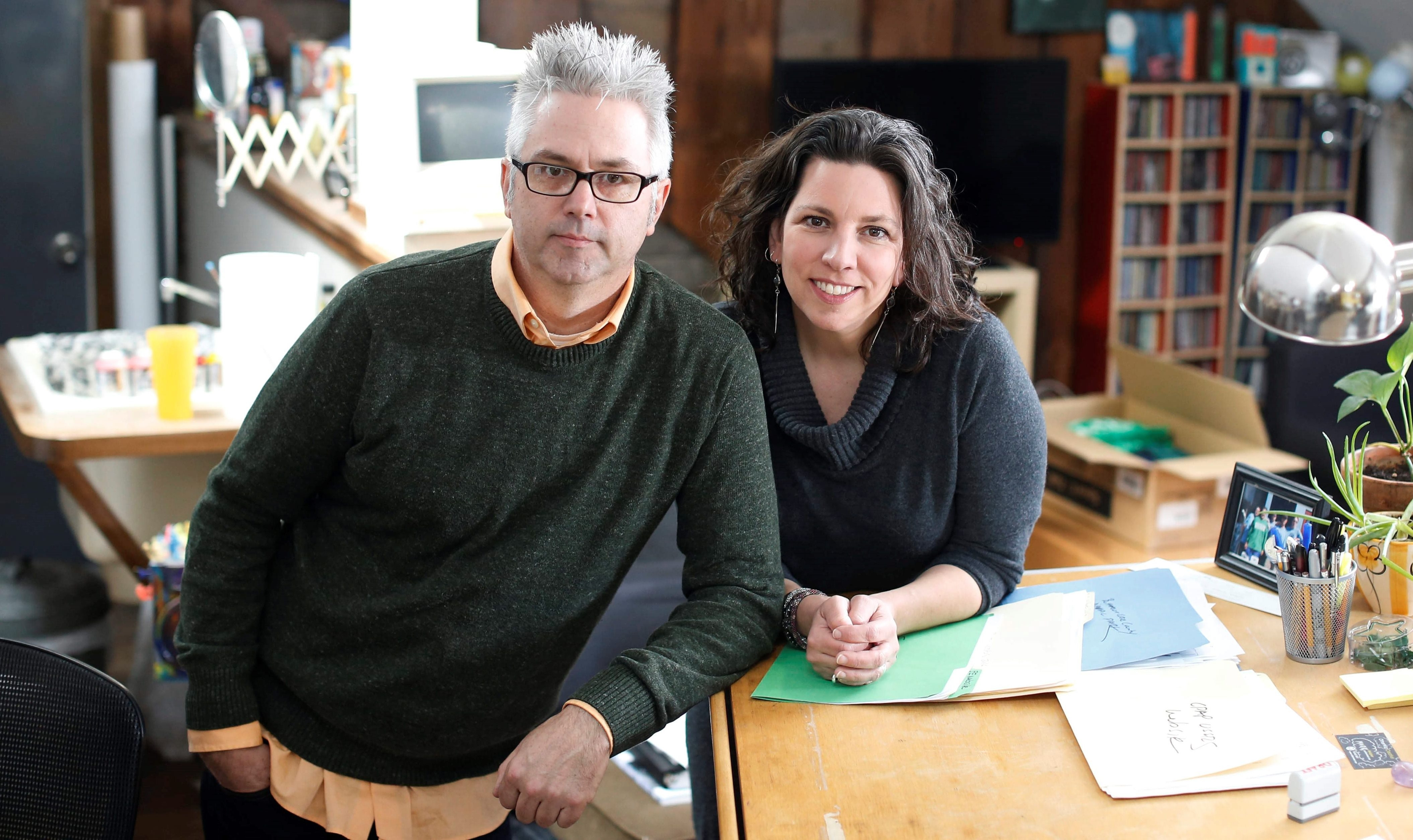 Mark and Jill Wisz are seen in their OtherWisz Creative office in the Elmwood Village. (Derek Gee/Buffalo News)