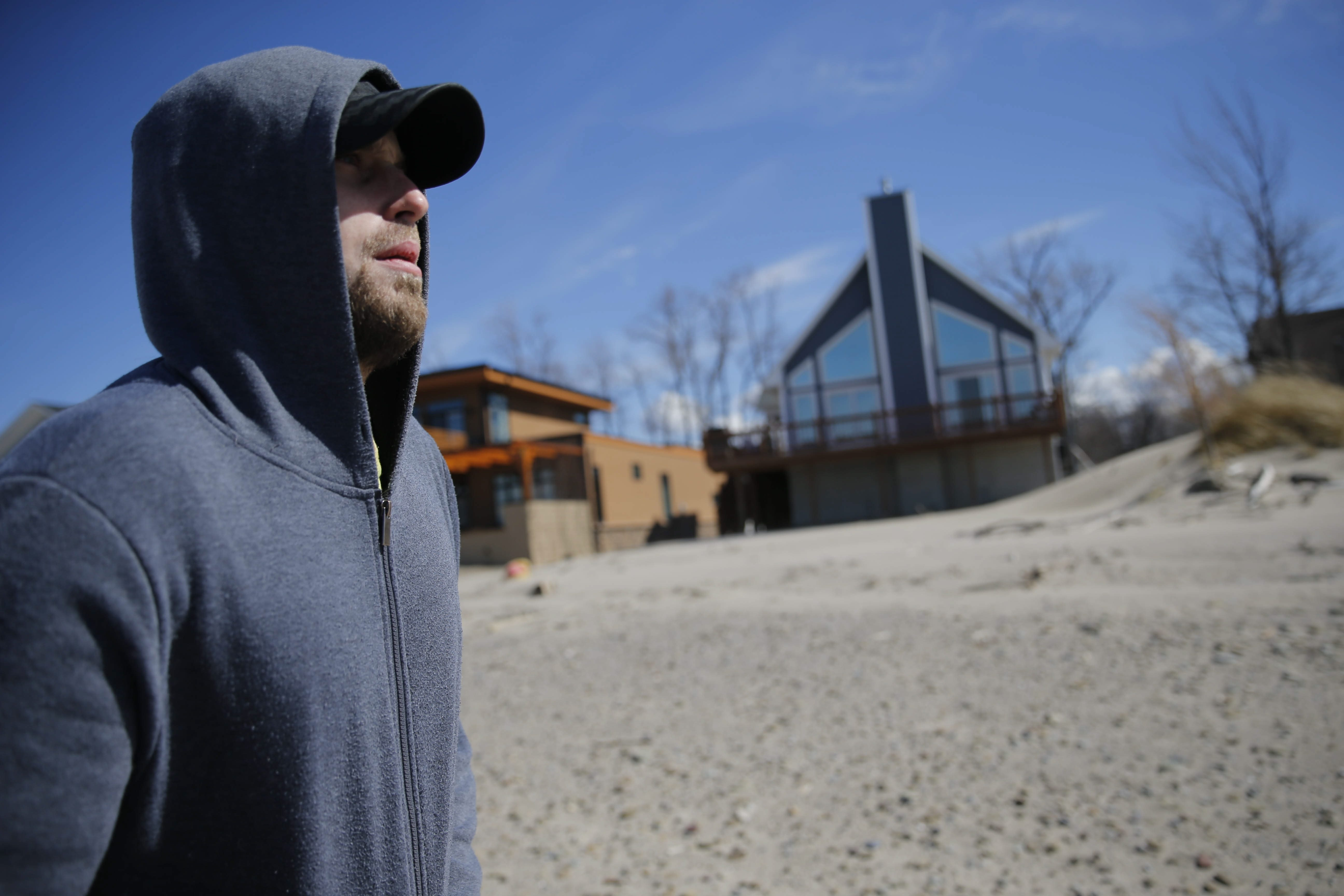 Adam O'Connor walks near State. Sen. Marc C. Panepinto's Sunset Bay beach house, where he used to be a tenant. He says he was evicted after reporting a loud party with underage drinking to law enforcement.