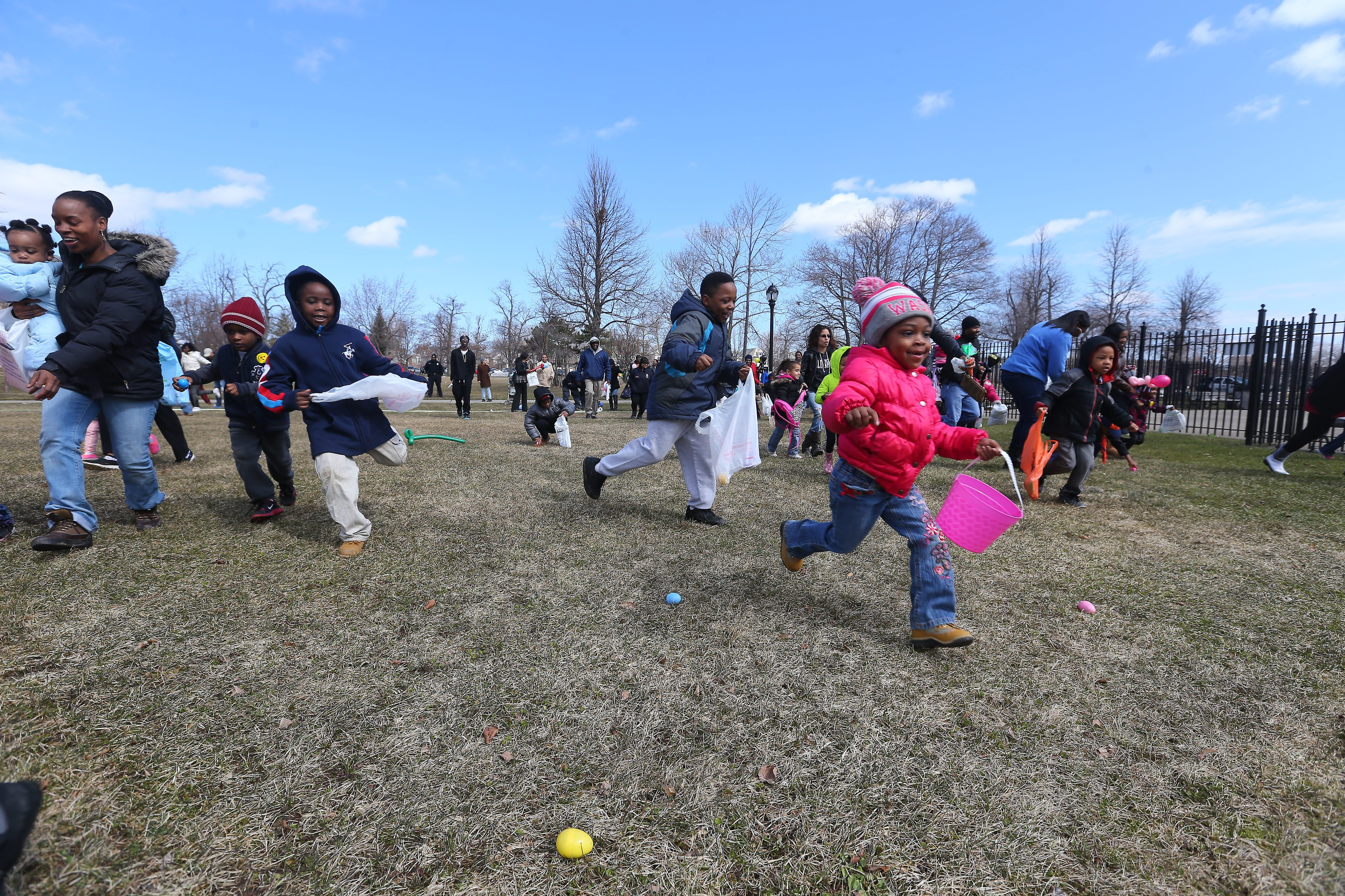 Kids race to find Easter eggs during an egg hunt at MLK park in Buffalo last year.    (Mark Mulville/Buffalo News)