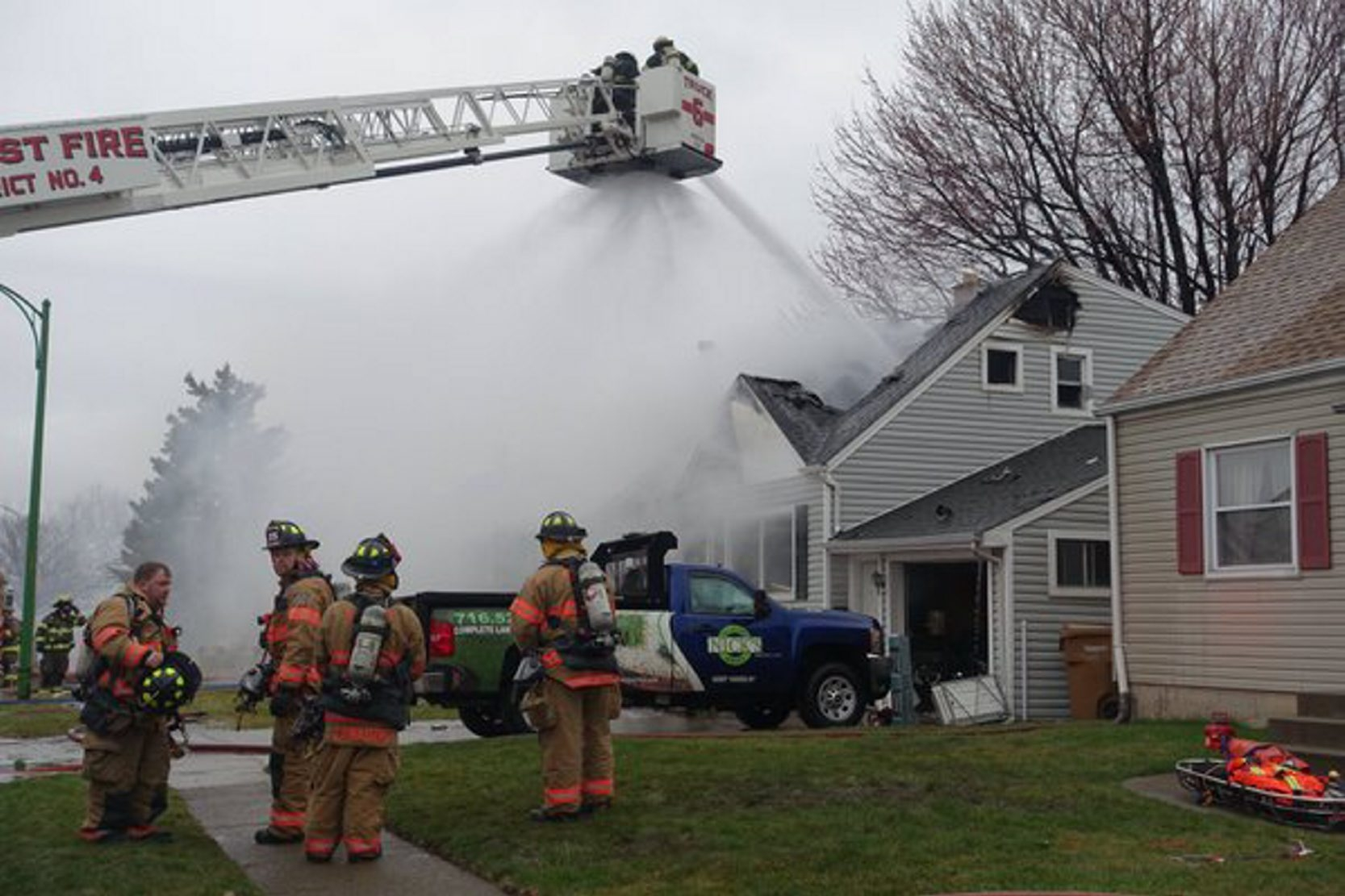 U-Crest firefighters battle a house fire at 163 Harris Court in Cheektowaga with mutual aid from surrounding companies. (John Hickey/Buffalo News)