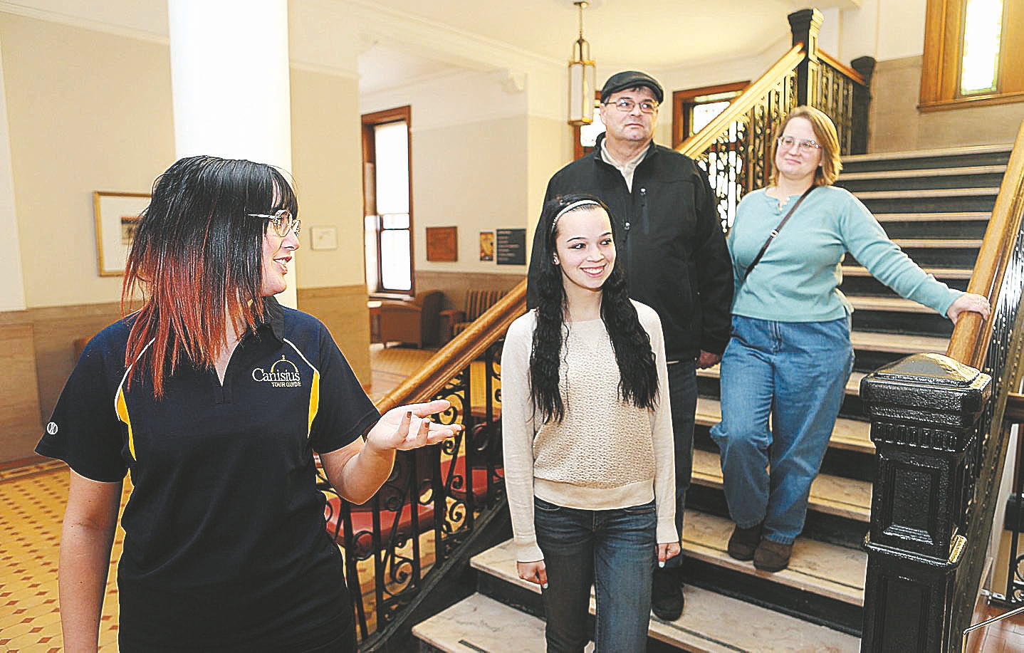 Canisius College student Molly Rutter, left, talks with high-schooler Lauren Torrisi and her parents, Donna and Joe, during a tour in 2014.