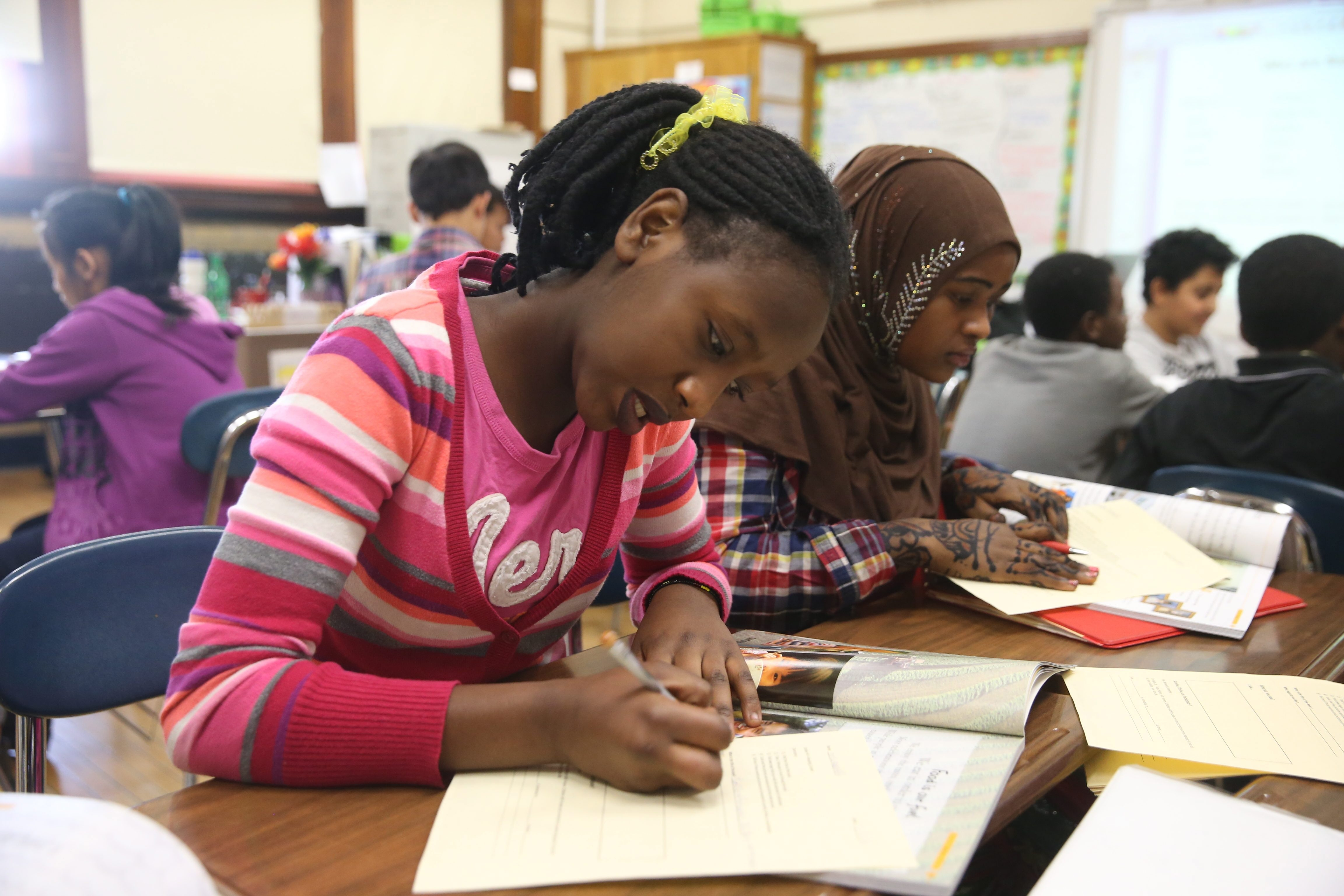 Mfufakazi Martin, left, and Sahara Yusuf work in an English as a Second Language class at the Newcomers Academy at Lafayette High School earlier this month.