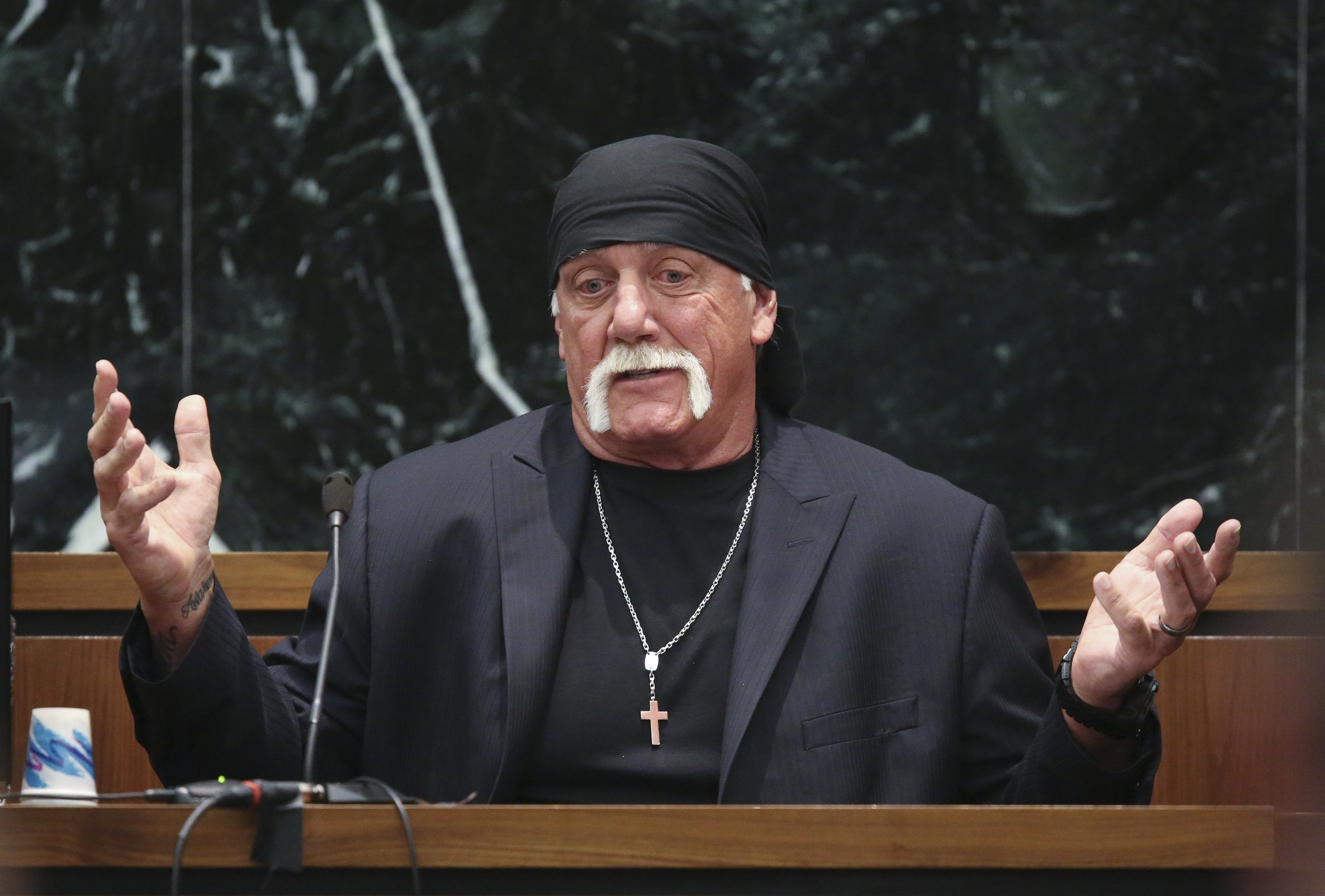 Terry Bollea, aka Hulk Hogan, testifies under cross-examination in his $100 million defamation against Gawker Media, in St. Petersburg, Fla., March 8, 2016. A lawyer for Gawker, which posted a video of Bollea having extra-marital sex in 2012, said that his penchant for flaunting sexual conquests was material to the case; Bollea maintained it was purely an act and part of his wrestling persona. (John Pendygraft/Pool via The New York Times) -- FOR EDITORIAL USE ONLY --