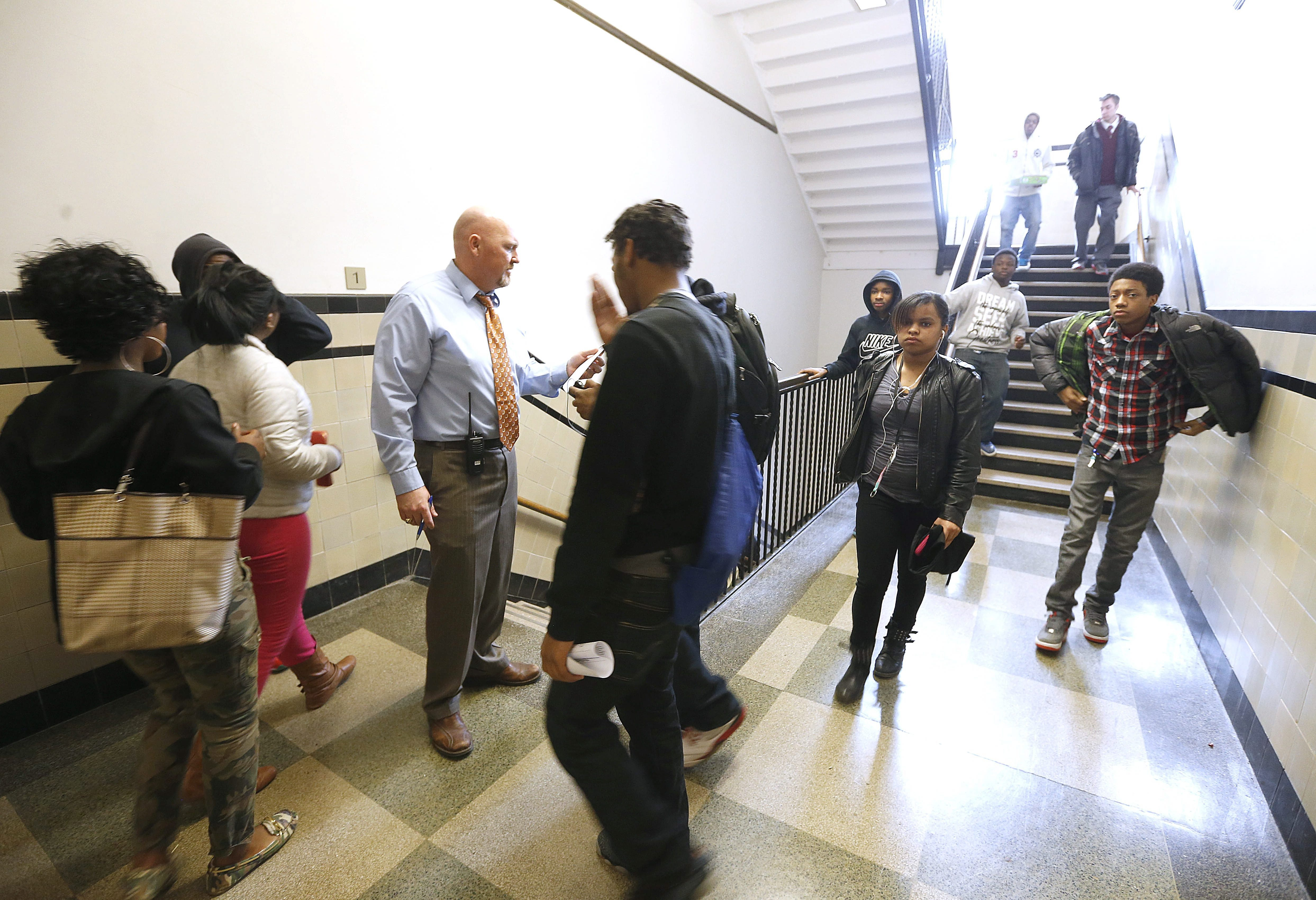 Principal Casey Young visits with students at the end of the school day at East High School in this 2014 photo.