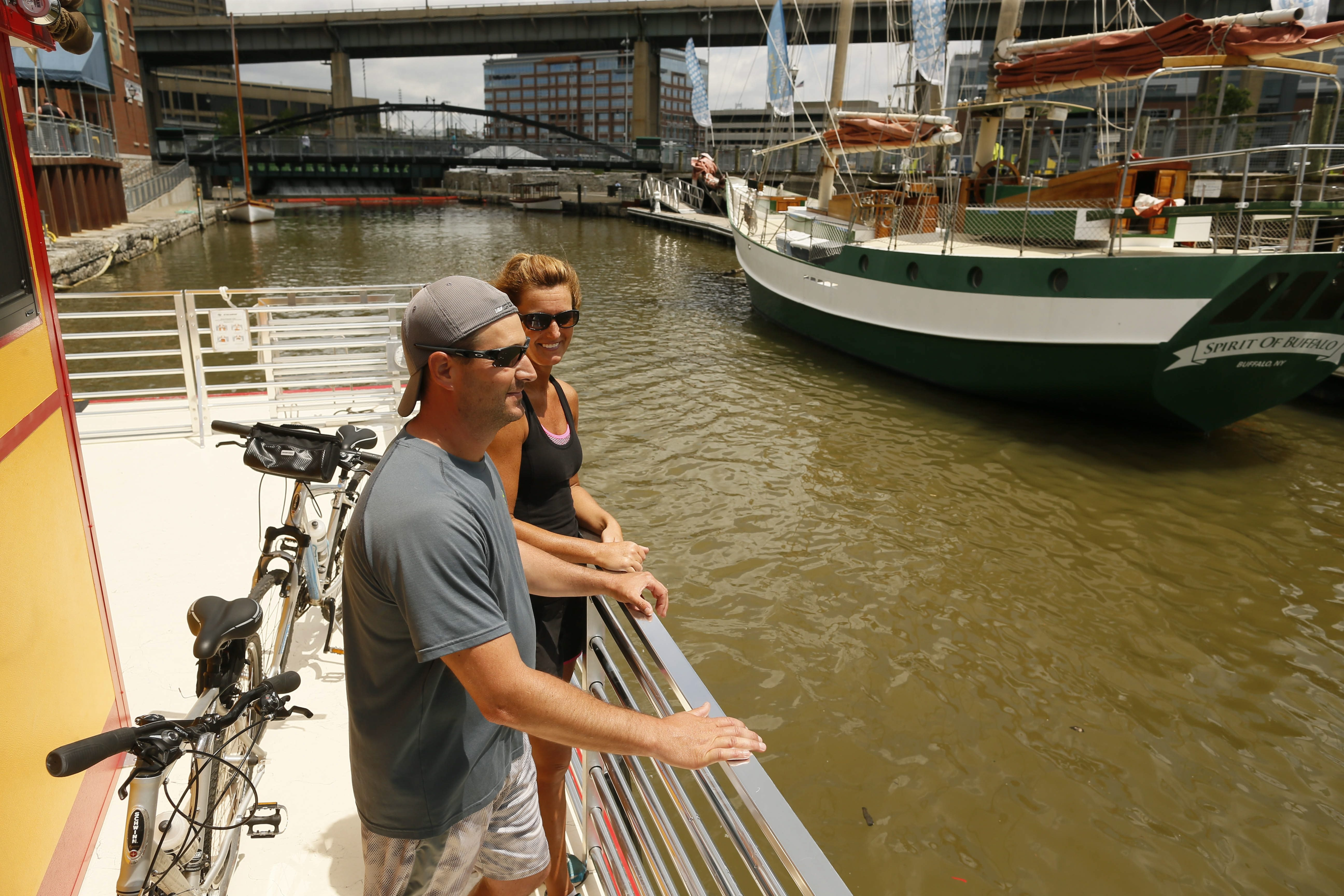 Tim and Jen Creighton ride the bike ferry across the Buffalo River in June 2015.