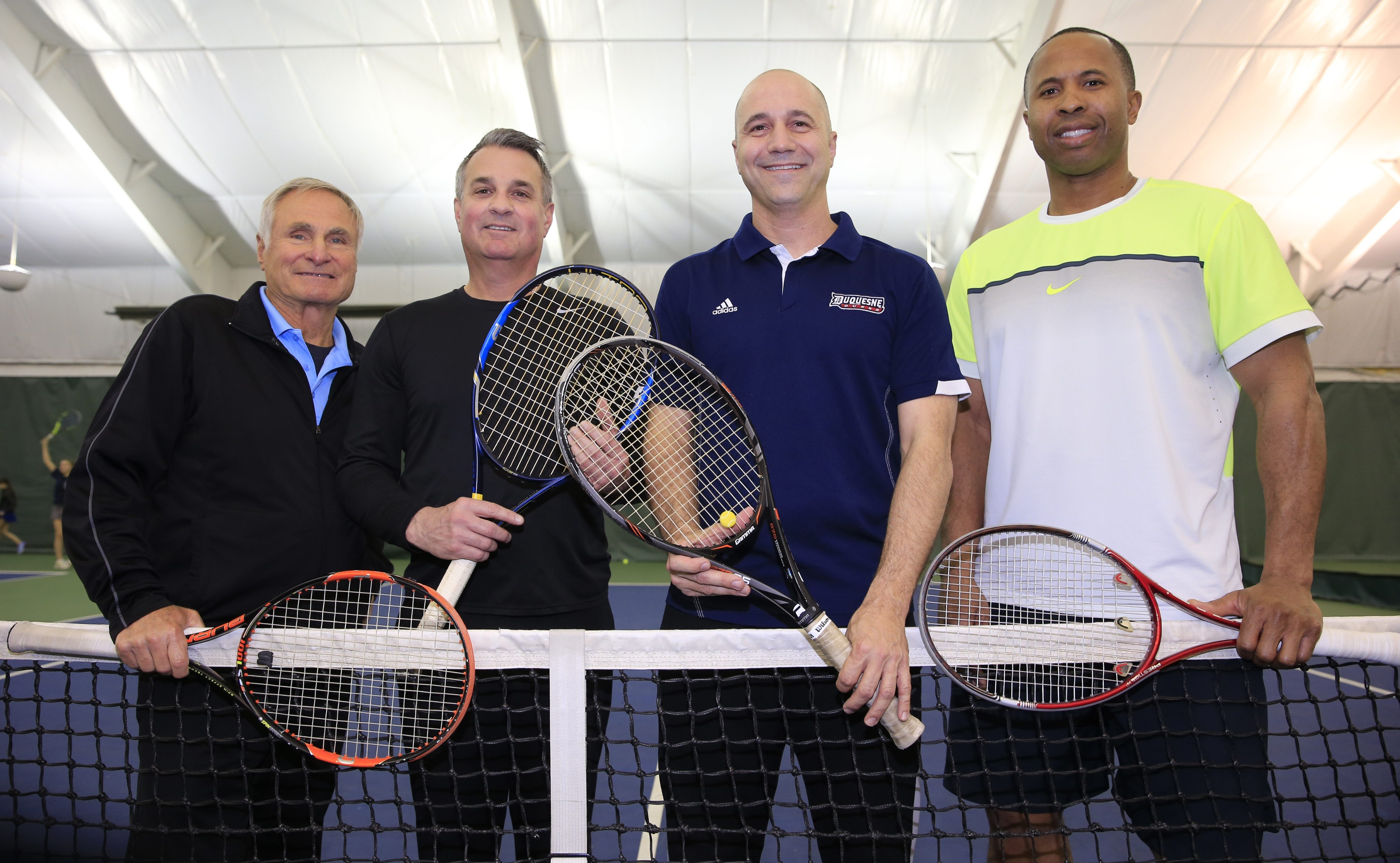 Rob Gregoire, third from left, is the new tennis director at Village Glen and heads a staff or pros that includes, from the left, Tom LaPenna, Russ Tringali Jr. and Ross Nwachukwu.