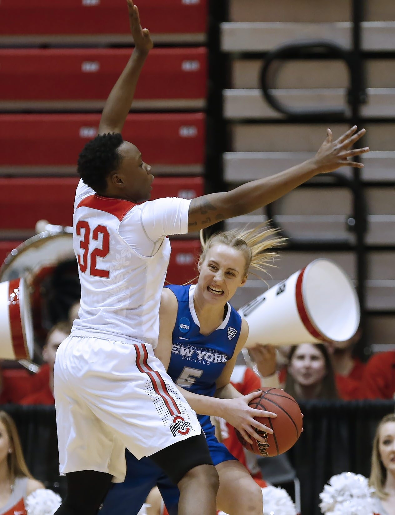 UB's Katherine Ups covets the ball under pressure from Ohio State's Shayla Cooper.