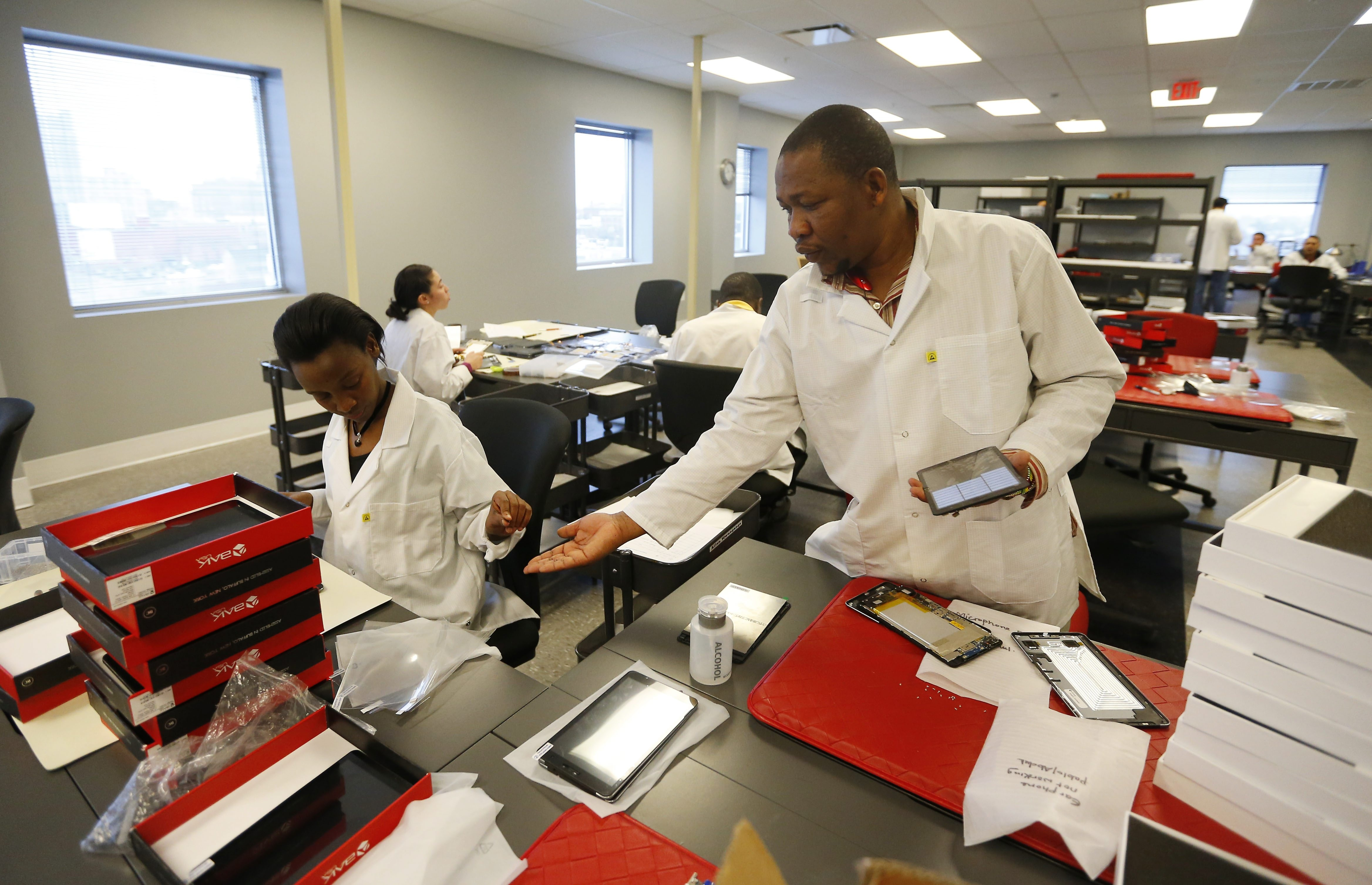 Workers produce tablets at Bak USA headquarters on Michigan Avenue in Buffalo. (Mark Mulville/Buffalo News)