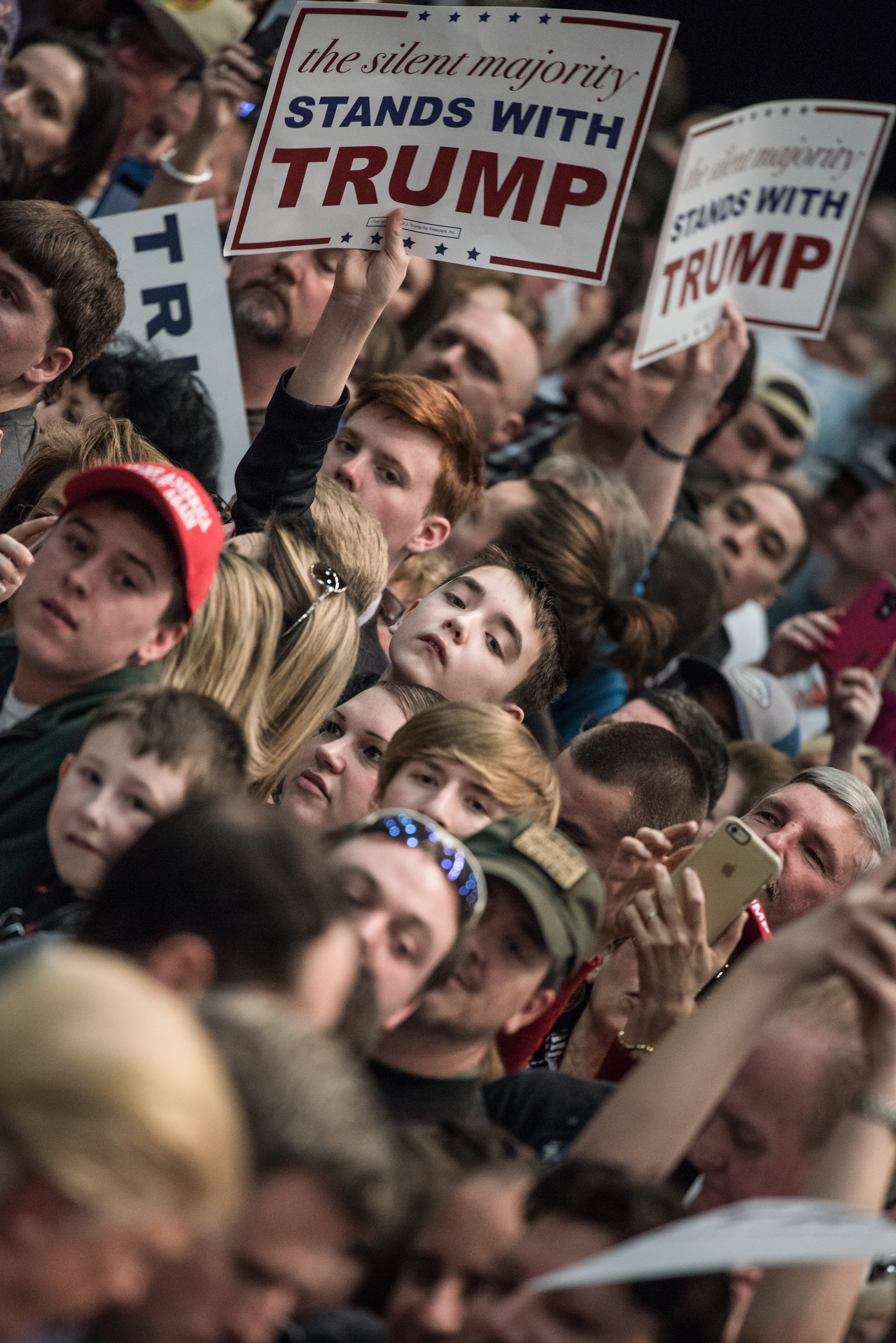 Donald Trump supporters wait for autographs from the Republican presidential candidate at a rally on March 7 in Concord, N.C.