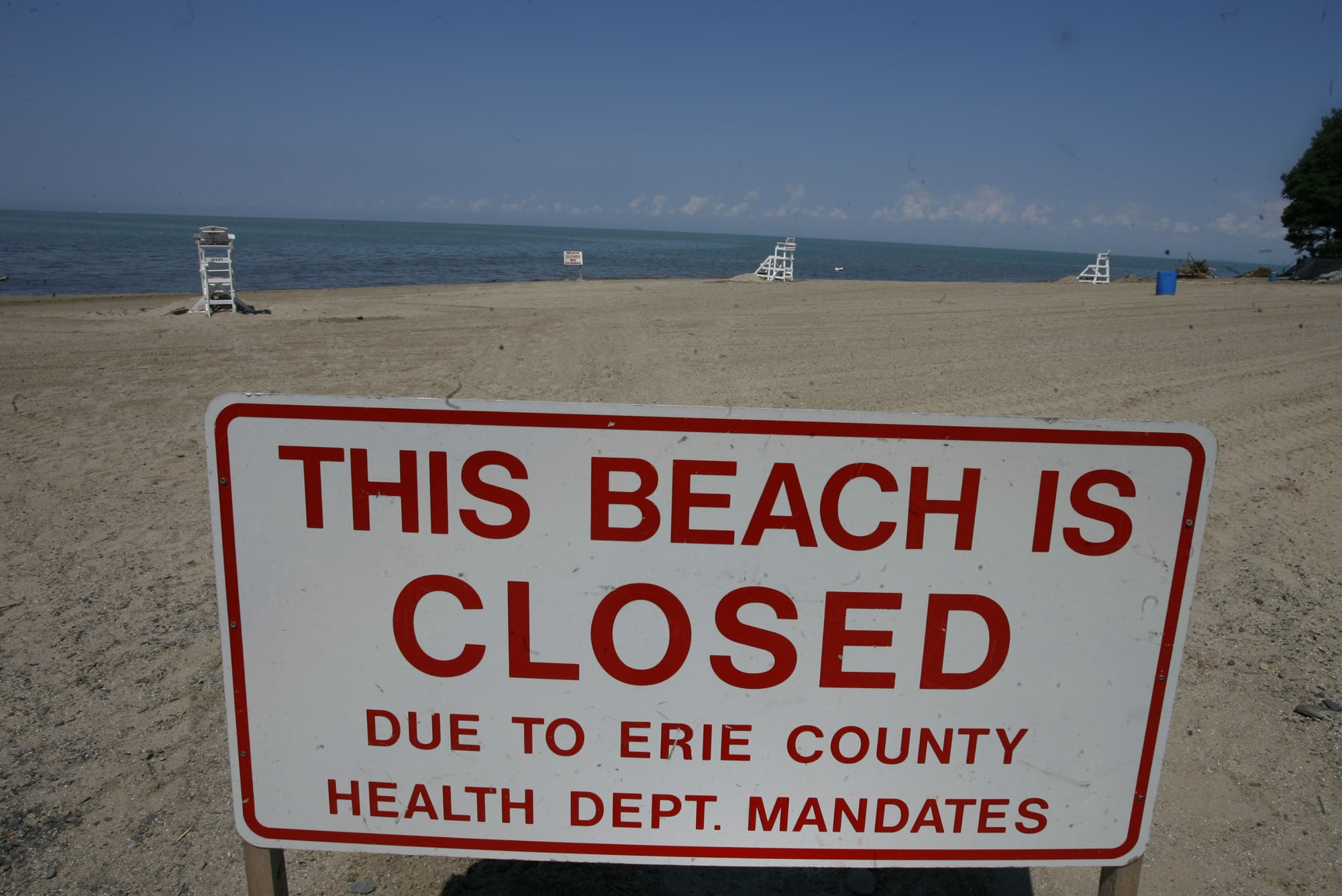 Harry Scull Jr./Buffalo News file photo  A beautiful beach on a hot summer day, but swimming is prohibited because of dangerous pollution. Lake Erie beach, above, was closed to swimming 39 days last summer.