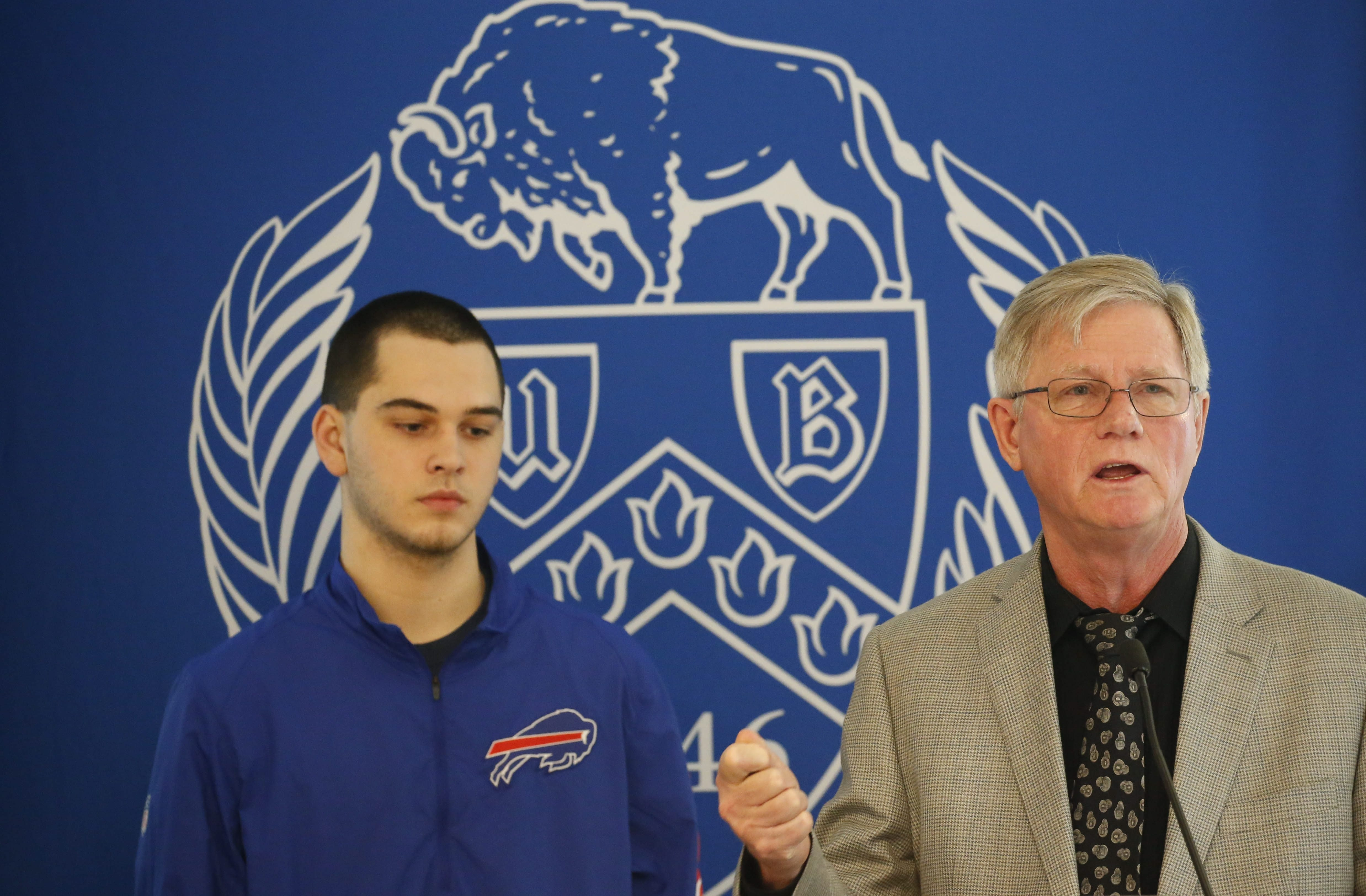 Sean Kaiser, a senior at Frontier High School, left, and Dr. Barry S. Willer, research director of the UB Concussion Management Clinic, during an announcement that UB has been awarded a five year, $2 million grant from the National Institutes of Health to study concussions, Tuesday, March 15, 2016.  (Derek Gee/Buffalo News)