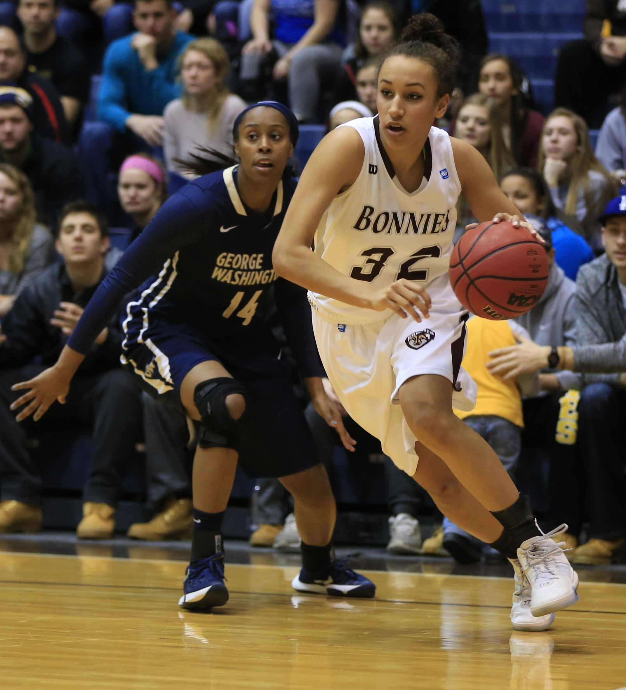 St. Bonaventure's Miranda Drummond drives on George Washington during first-half action at the Reilly Center on Feb. 17, 2016.