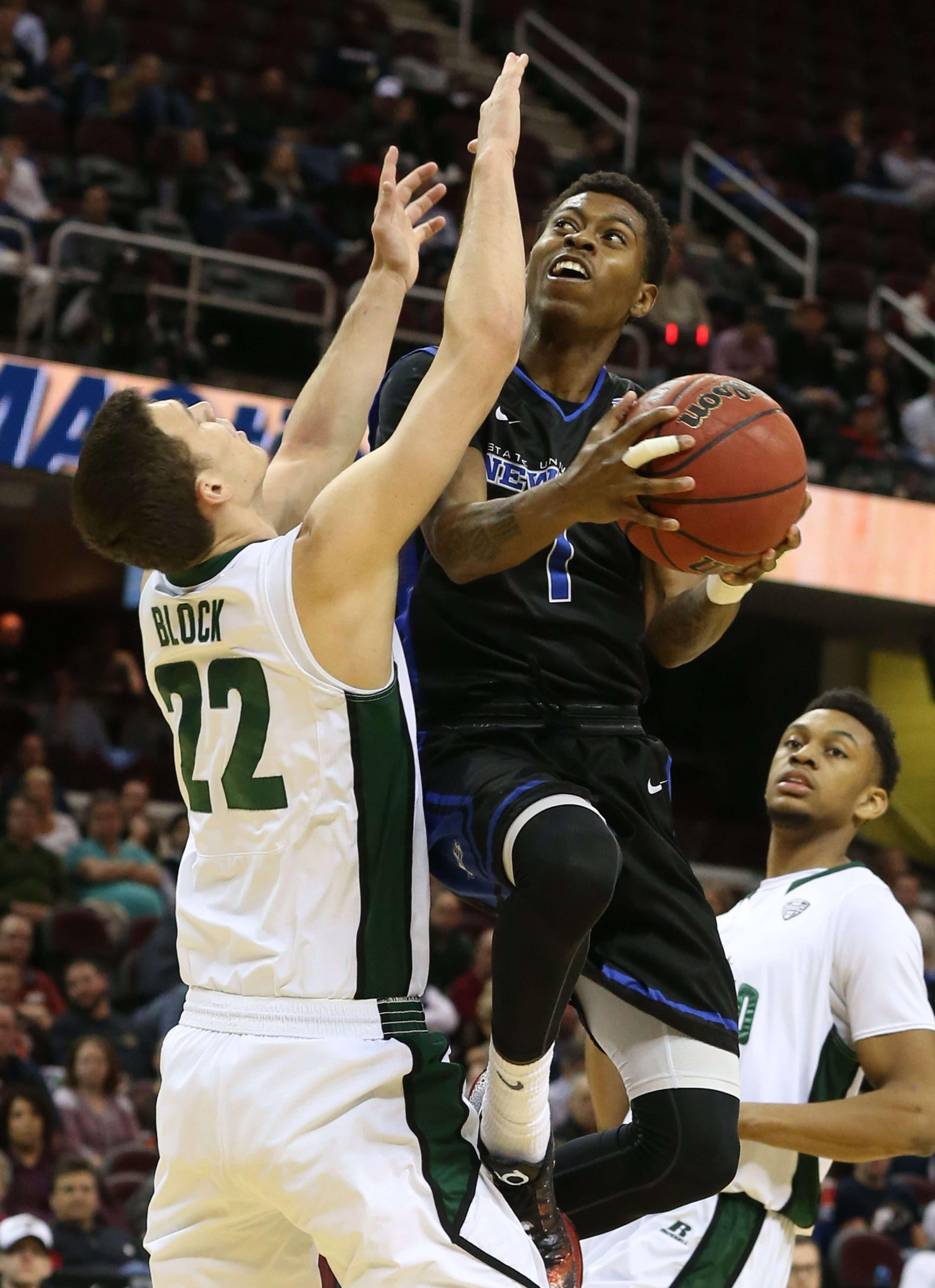 At left, UB's Lamonte Bearden (1) scores two points over Ohio Bobcats. At center, UB's Stephanie Reid scores the winning shot over Central Michigan. At right, Bona's Katie Healy shoots against George Washington.