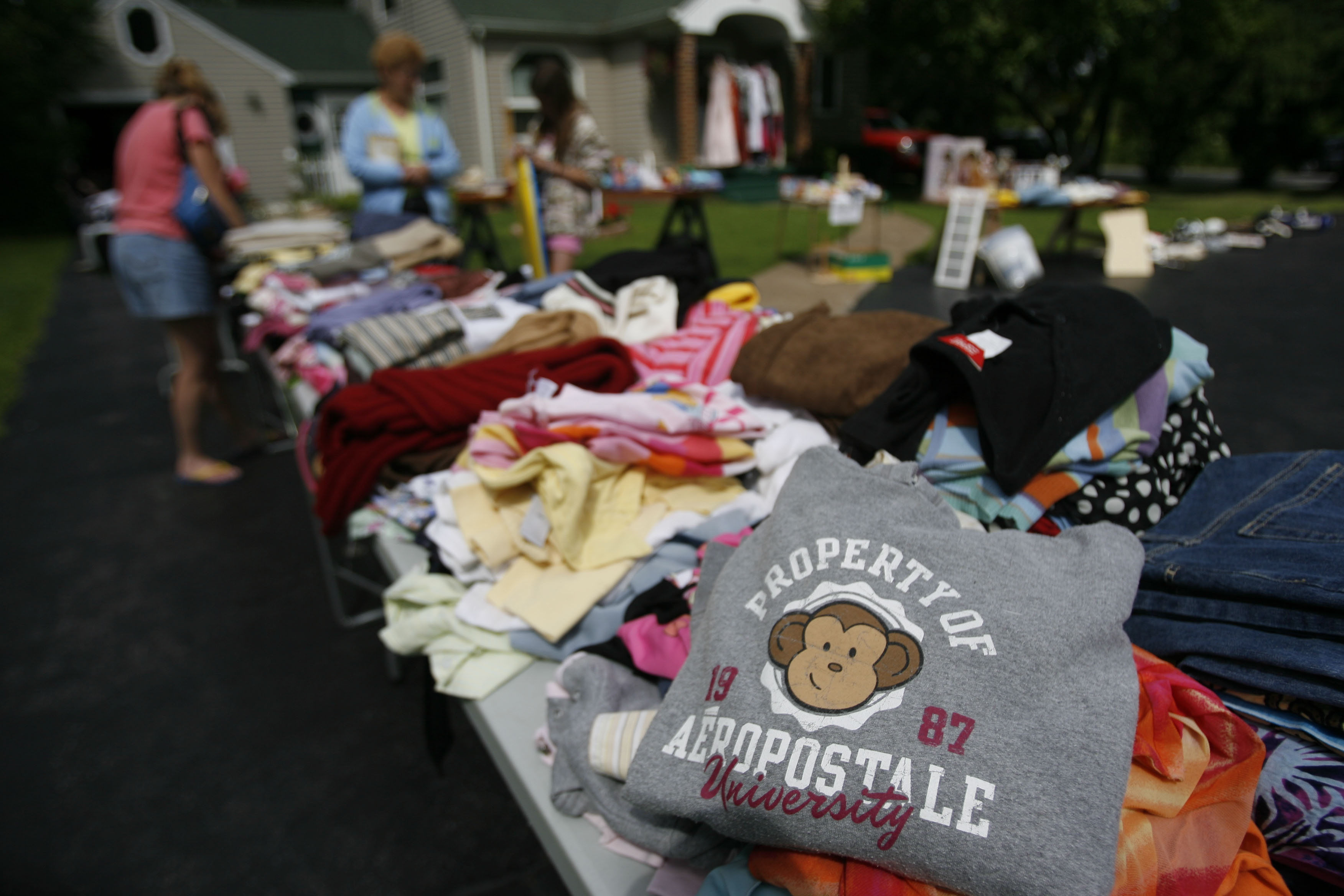 Articles of clothing for sale at a garage sale in Amherst on July 18th, 2009.  PHOTO BY CHARLES LEWIS