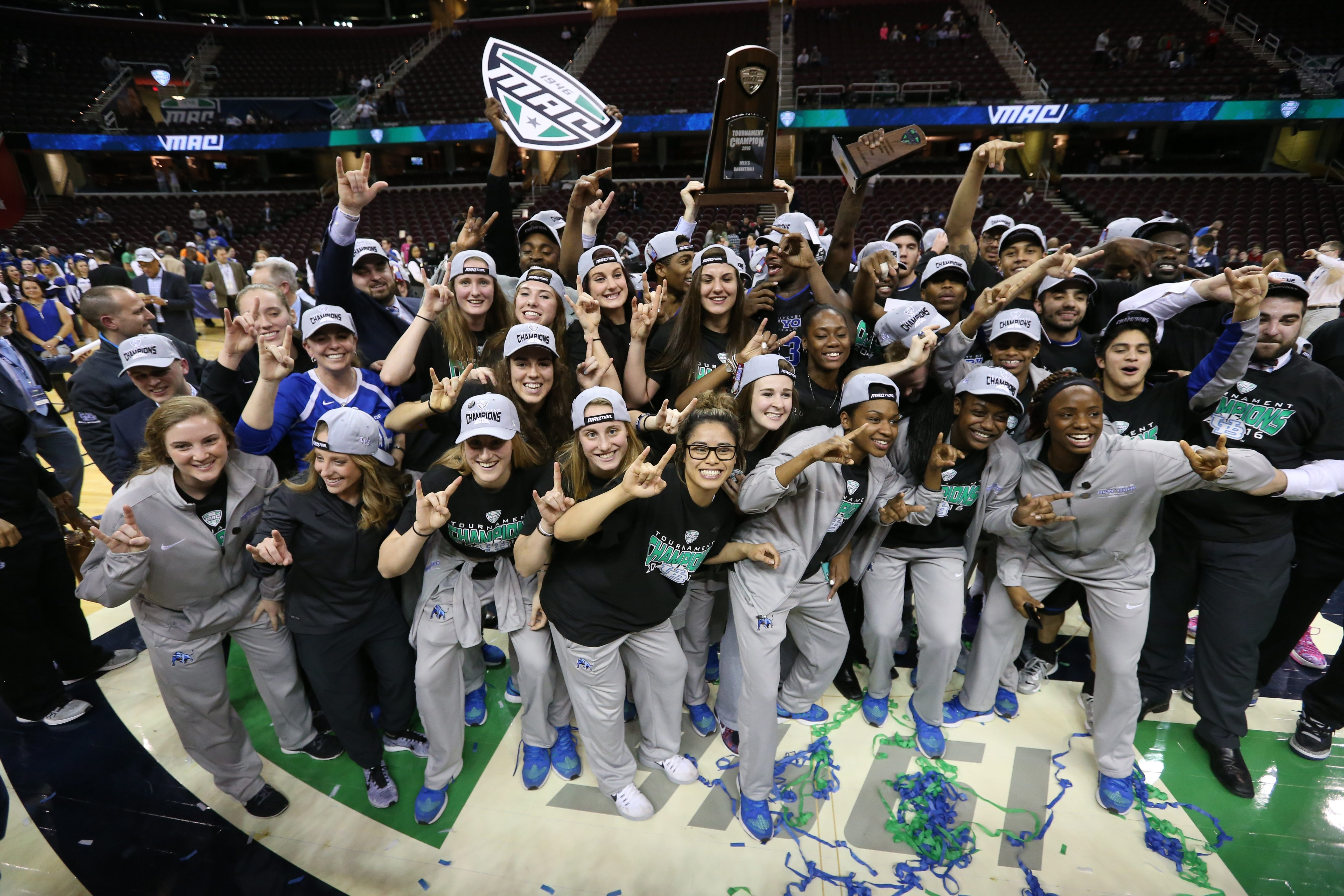 University at Buffalo men's and women's teams get together for a group picture after each won a MAC basketball championship in dramatic style Saturday in Cleveland.