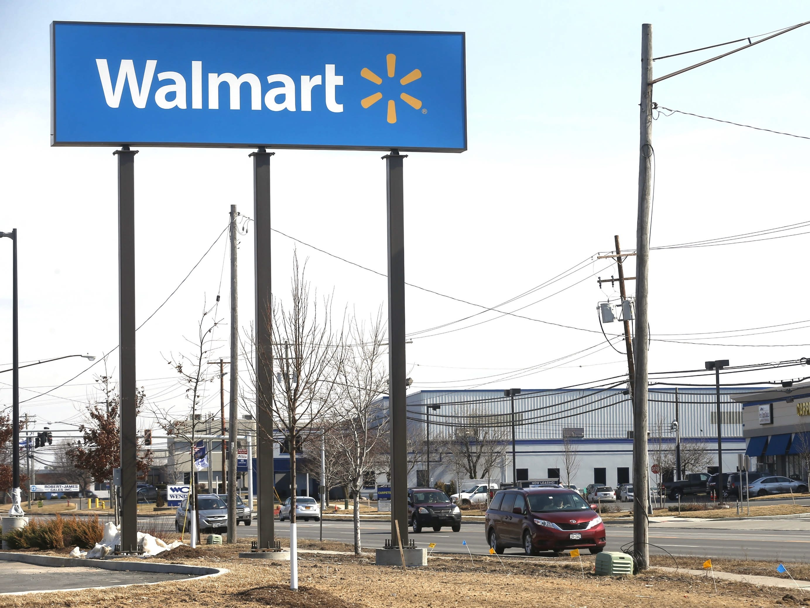 Walmart officials say an on-site bus stop for its new store should have been discussed in the store's planning and design stages.