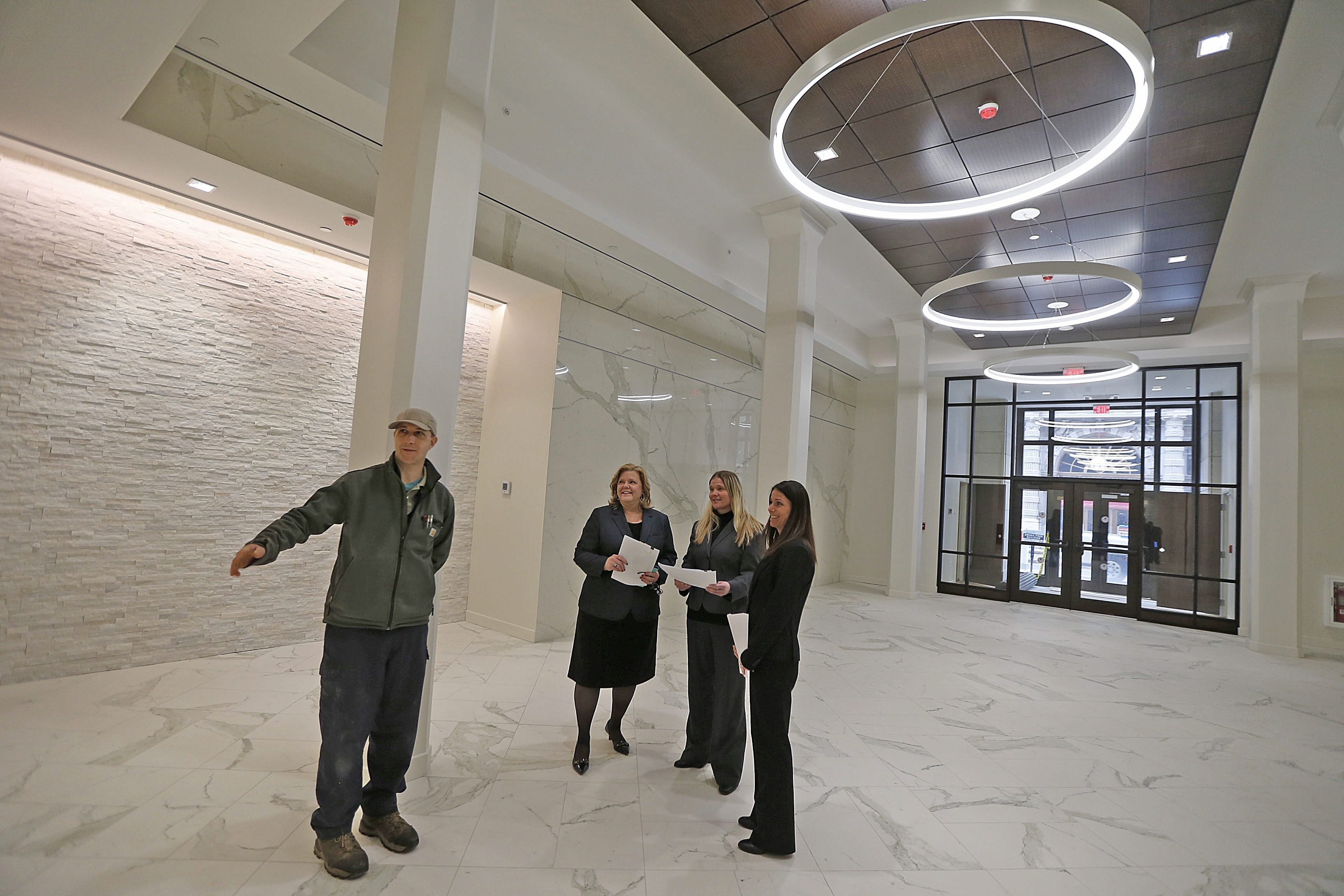 Among those overseeing Kissling Interests' renovations at 298 Main in downtown Buffalo are, from left, Amos Sweet, building superintendent; Rose Seege, vice president of operations and finance; and property managers Tamar Arroyo and Heather Klienfelder.