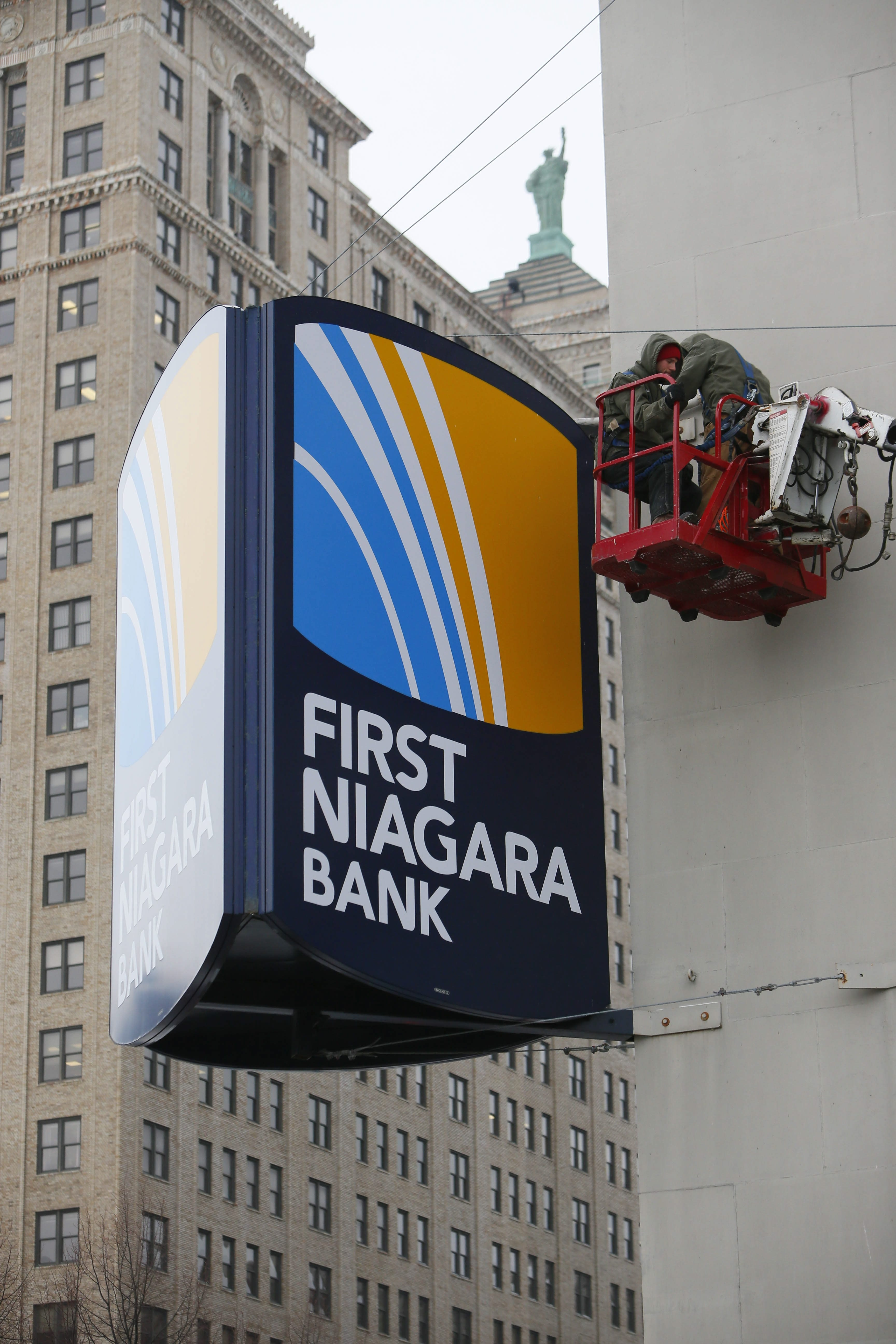 First Niagara Financial Group and Key Corp. have settled a lawsuit filed by shareholders after the Key takeover of First Niagara was announced. (Derek Gee/News file photo)