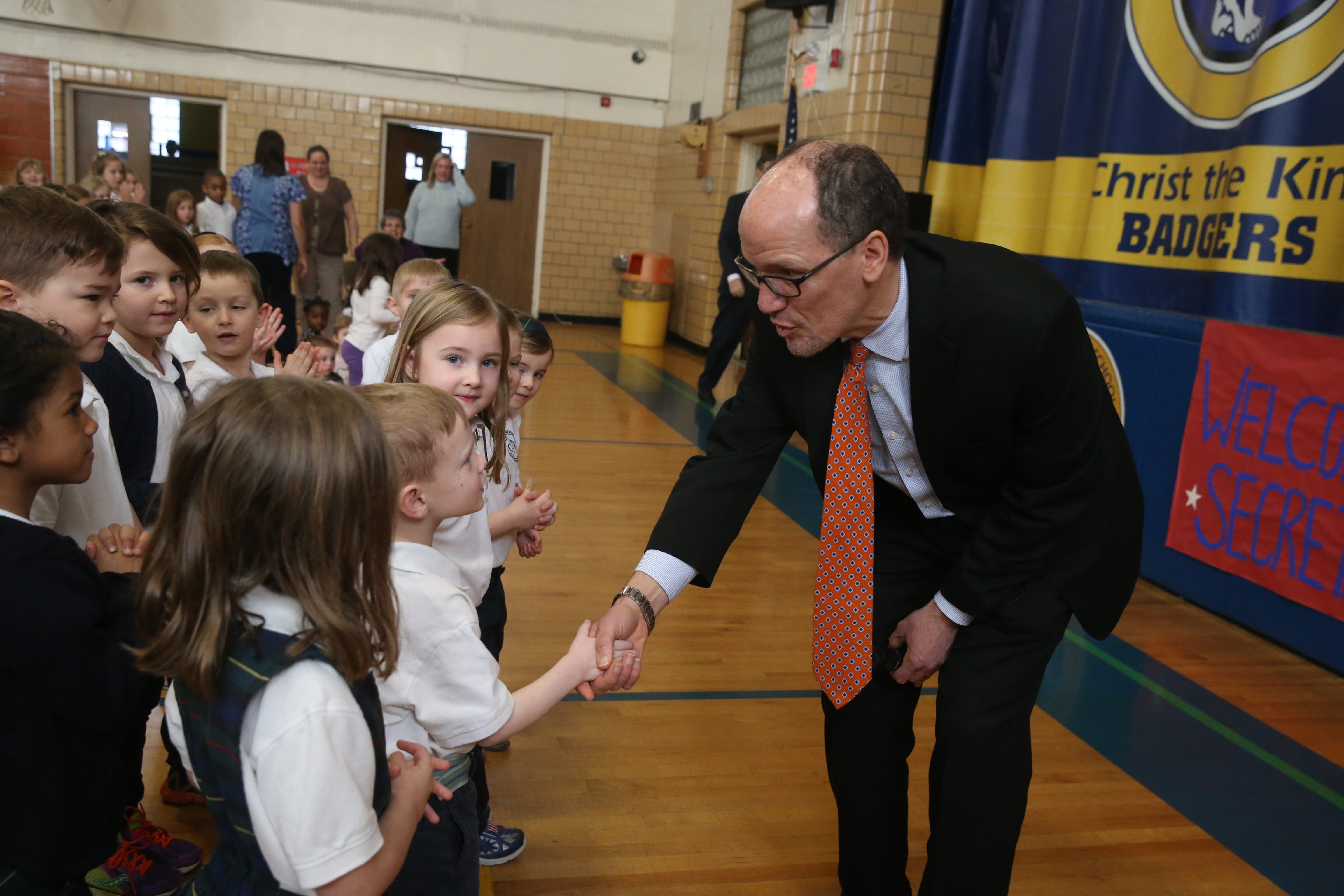 U.S. Labor Secretary Thomas E. Perez greets pupils Tuesday at Christ the King Elementary School in Snyder, which he attended four decades ago.