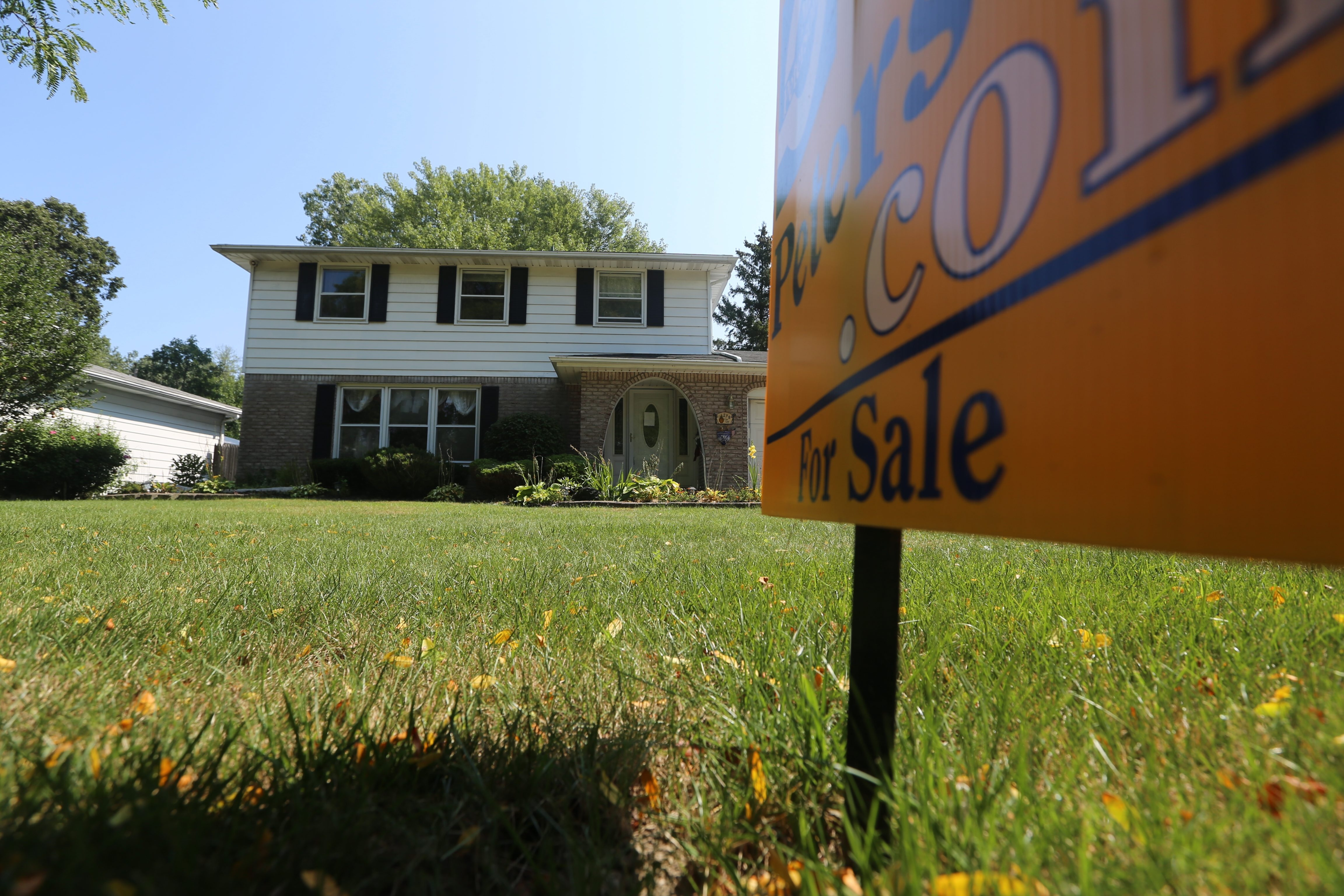 New listings of homes for sale, like this one in Amherst last year, declined in January despite relatively mild winter weather.