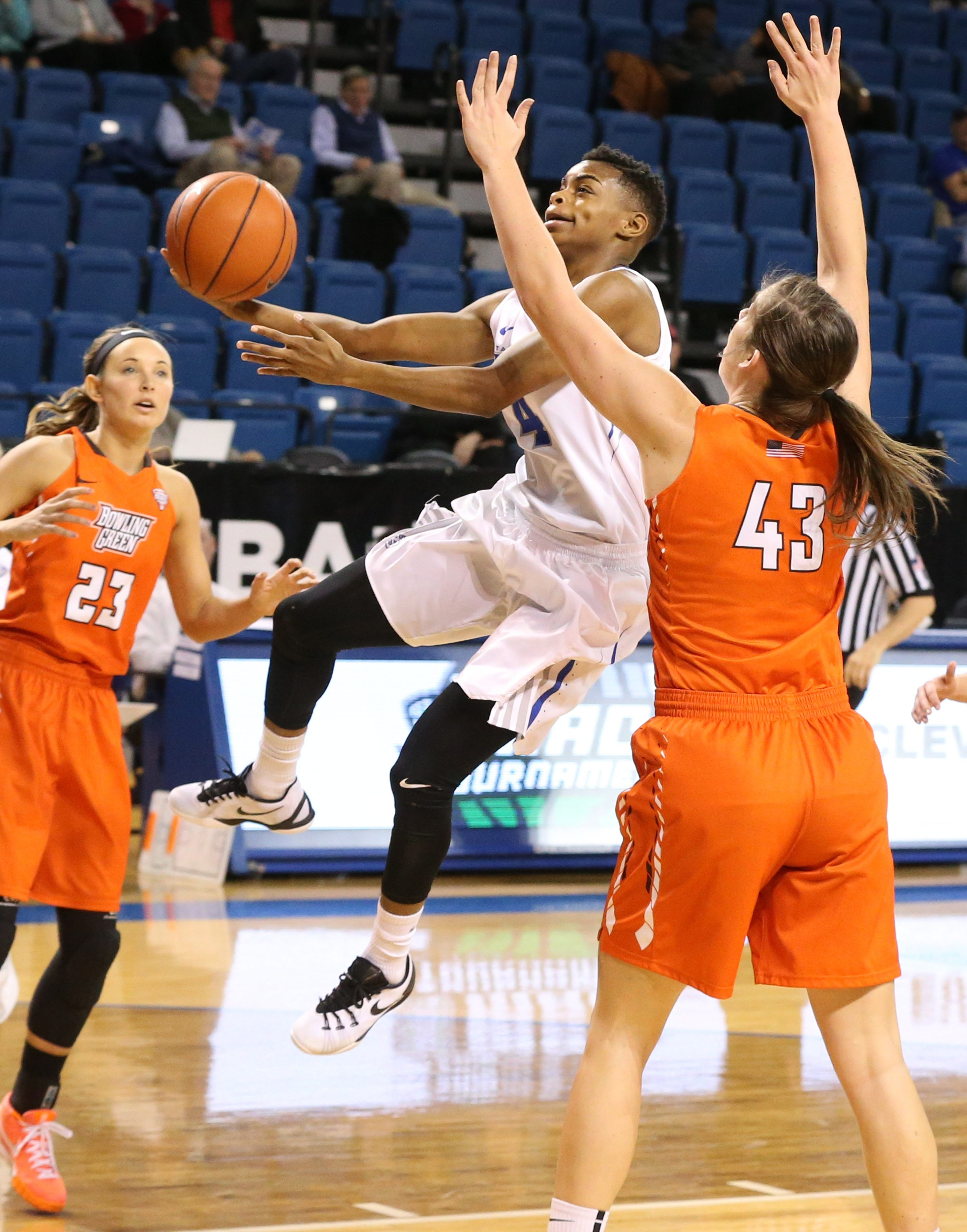 UB's all-conference guard Joanna Smith, center, goes up for a shot against Bowling Green in the MAC Tournament first-round game Monday night at Alumni Arena.