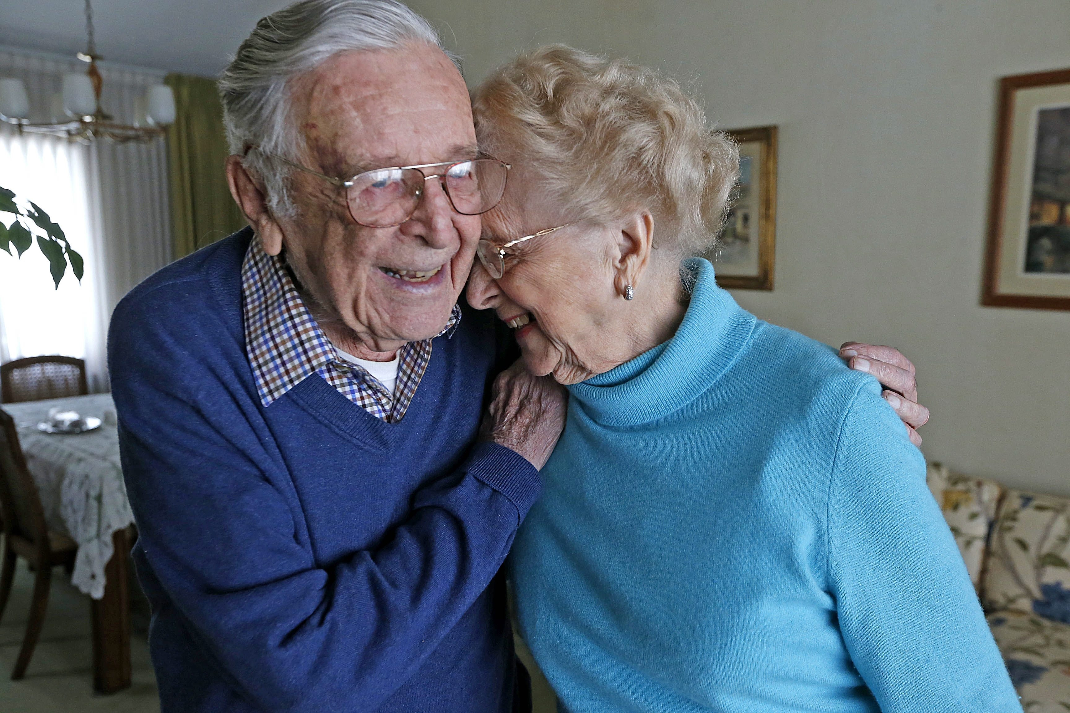 Elfi and Gunter Heinze, shown in their Amherst home Wednesday, experienced World War II as civilians living in Berlin.   After they came to America, Gunter was part of the program that developed the lunar module for landing on the moon.