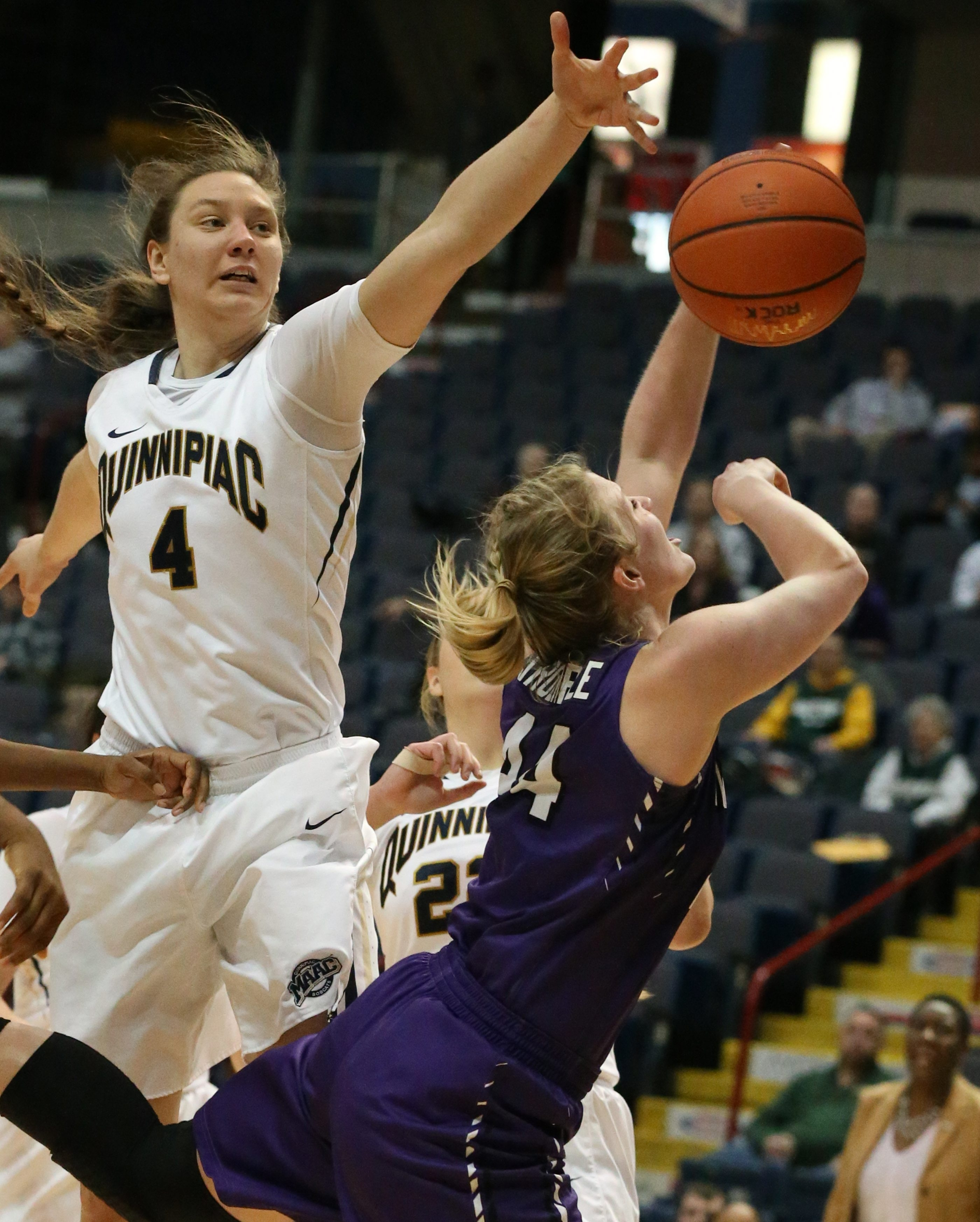 Kaylee Stroemple's shot was blocked by Quinnipiac's Aryn McClure and Paula Strautmane, left, Friday at the Times Union Center.