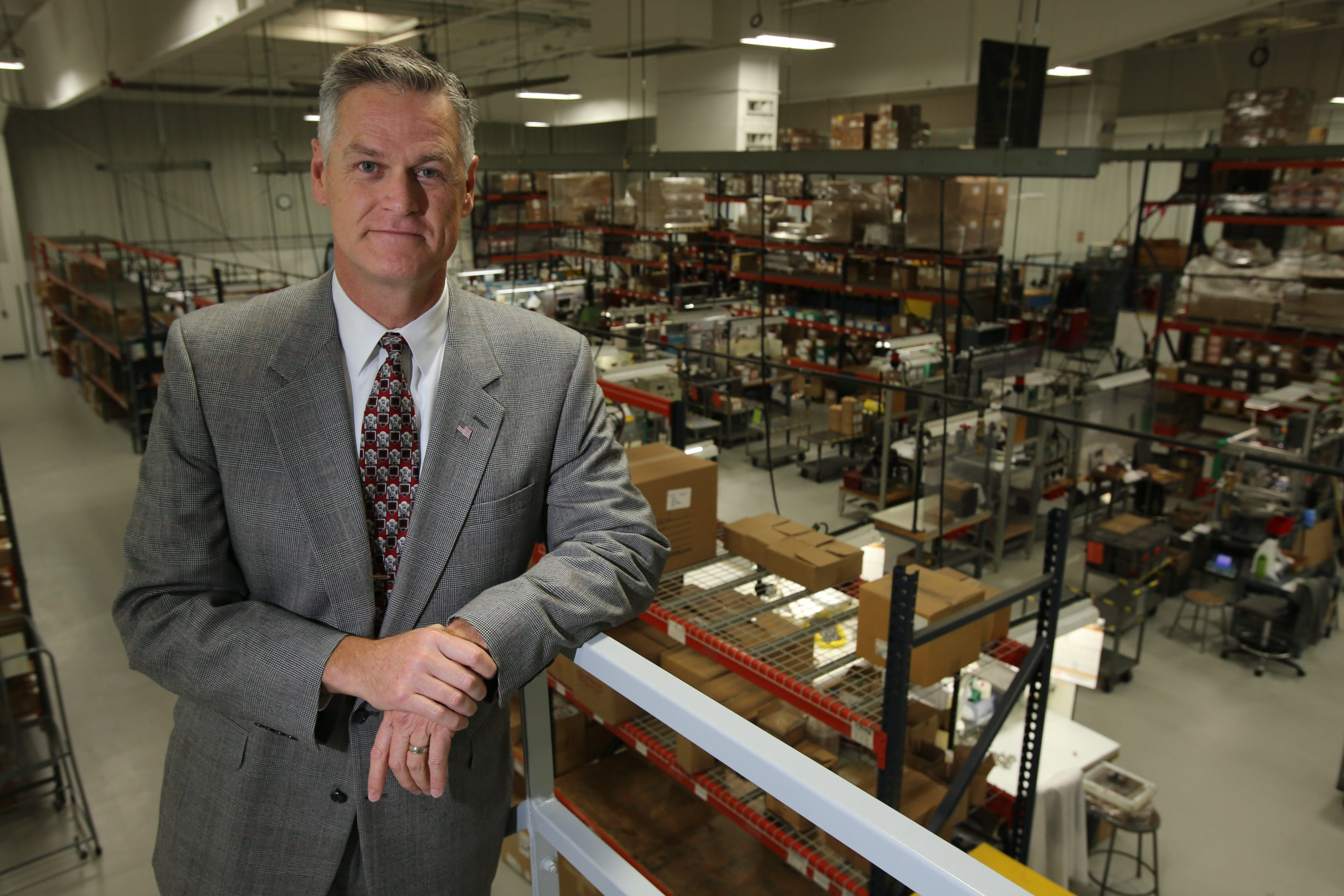 Michael Rayhill, president of Jiffy-Tite, stands in an assembly area at the company's Lancaster plant. (News file photo)