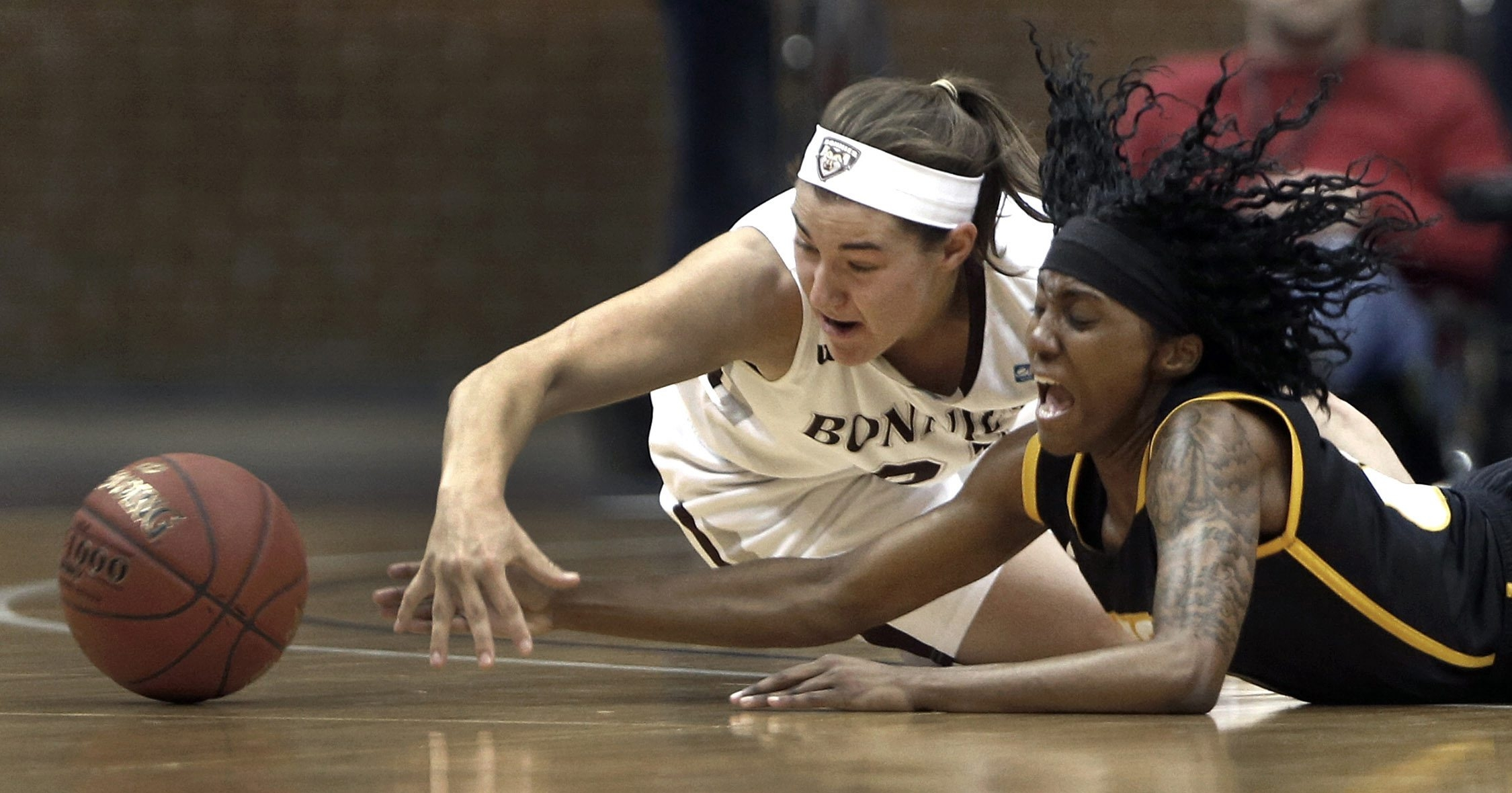 VCU's Ashley Pegram and St. Bonaventure's Nyla Reuter scramble to recover a loose ball in the first half of Friday's Atlantic 10 quarterfinals at the Richmond Coliseum. (Richmond Times-Dispatch)