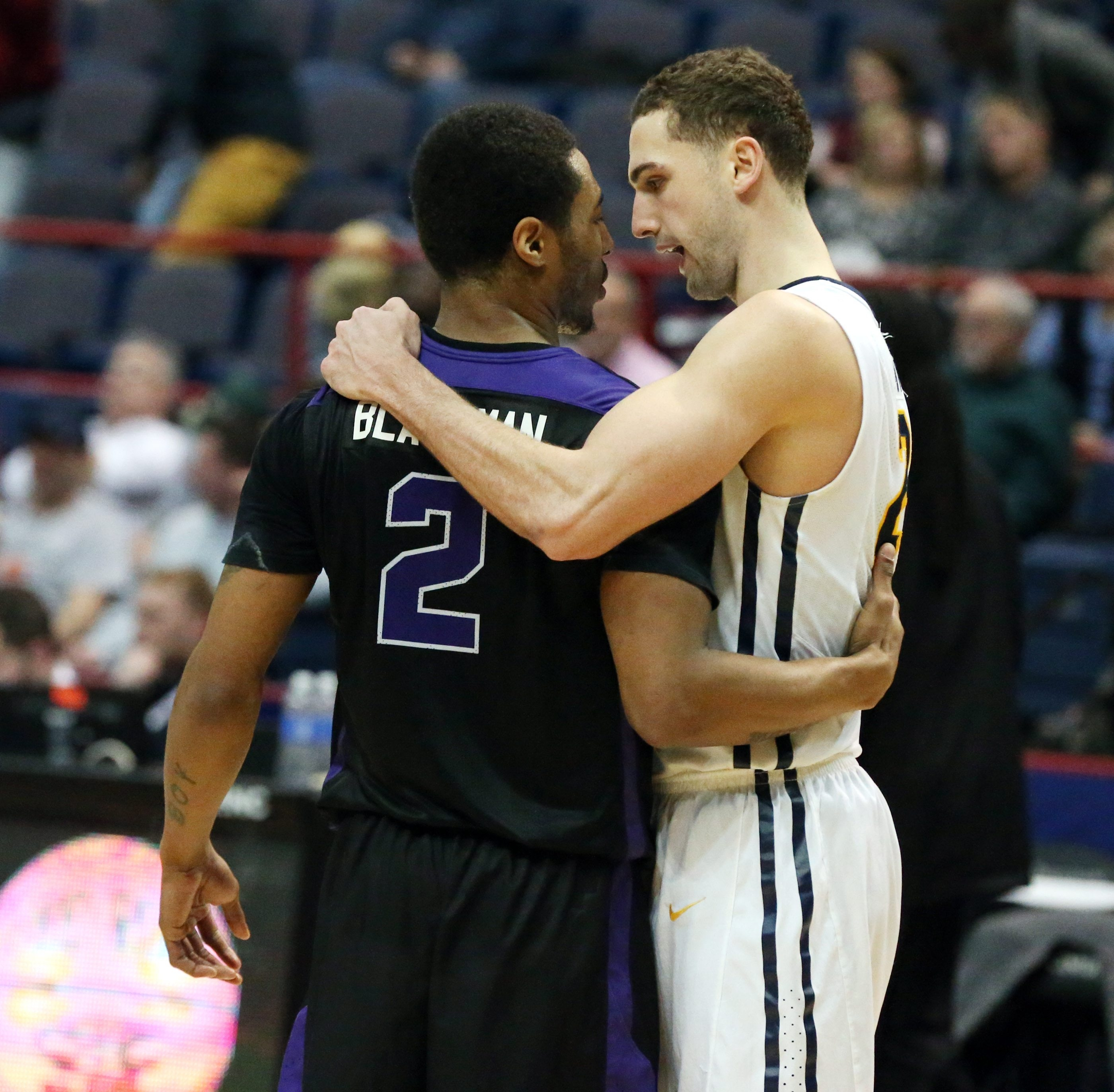 Niagara's Emile Blackman and Phil Valenti hug after the Griffs' 102-97 victory at the MAAC Tournament.