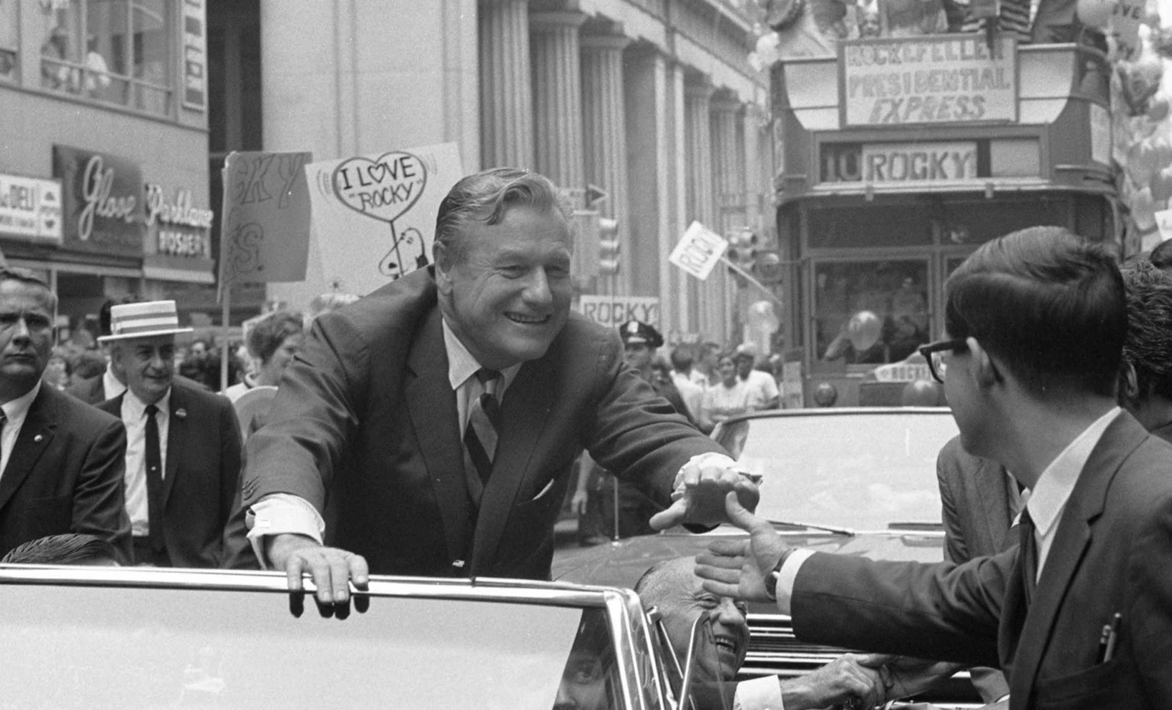 New York Gov. Nelson Rockefeller, riding in a car on Wall Street, campaigns for the Republican presidential nomination in 1968. (Library of Congress)