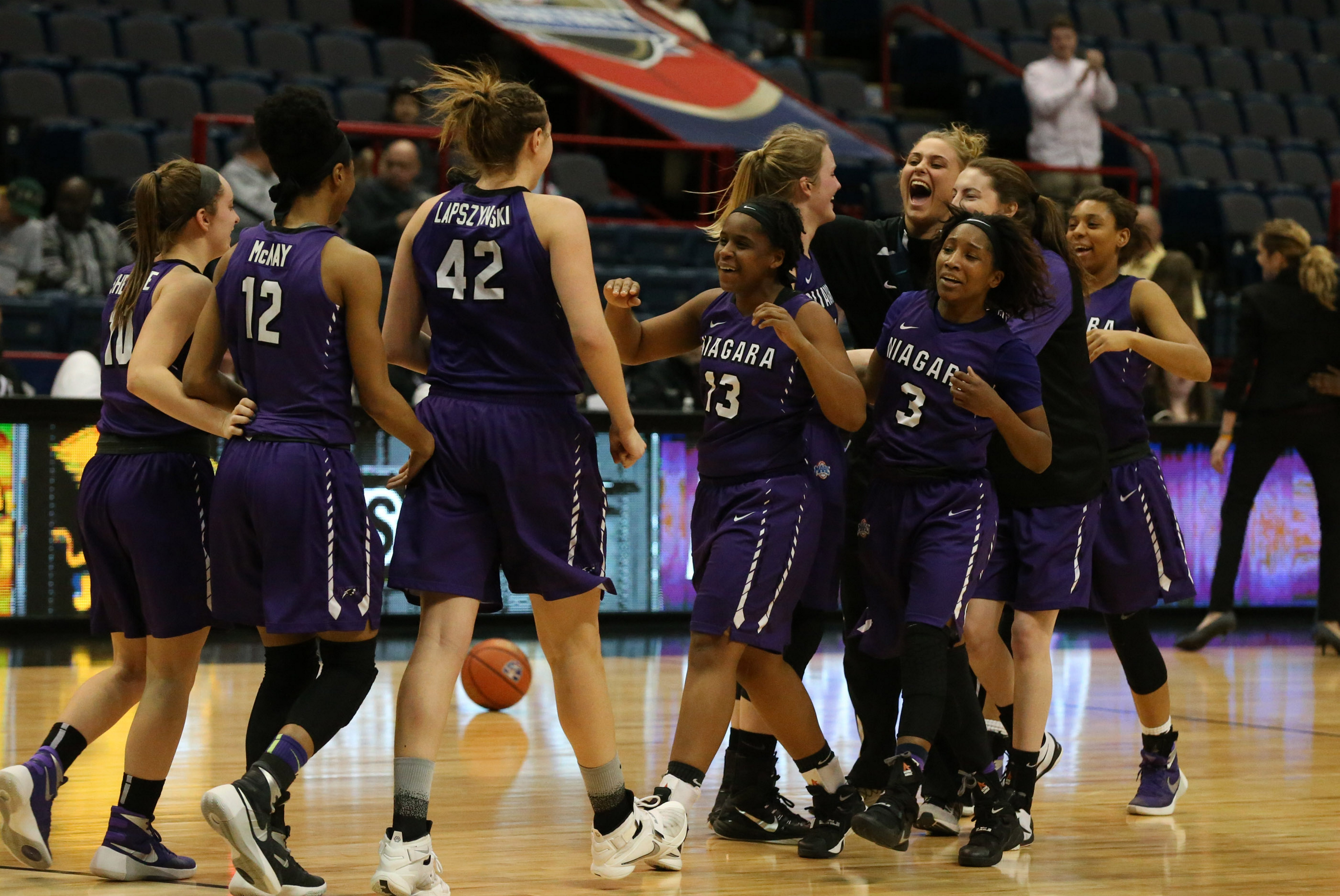 Niagara celebrates its 65-64 MAAC Tournament pre-quarterfinal victory over rival Canisius in Albany. (James P. McCoy/ Buffalo News)