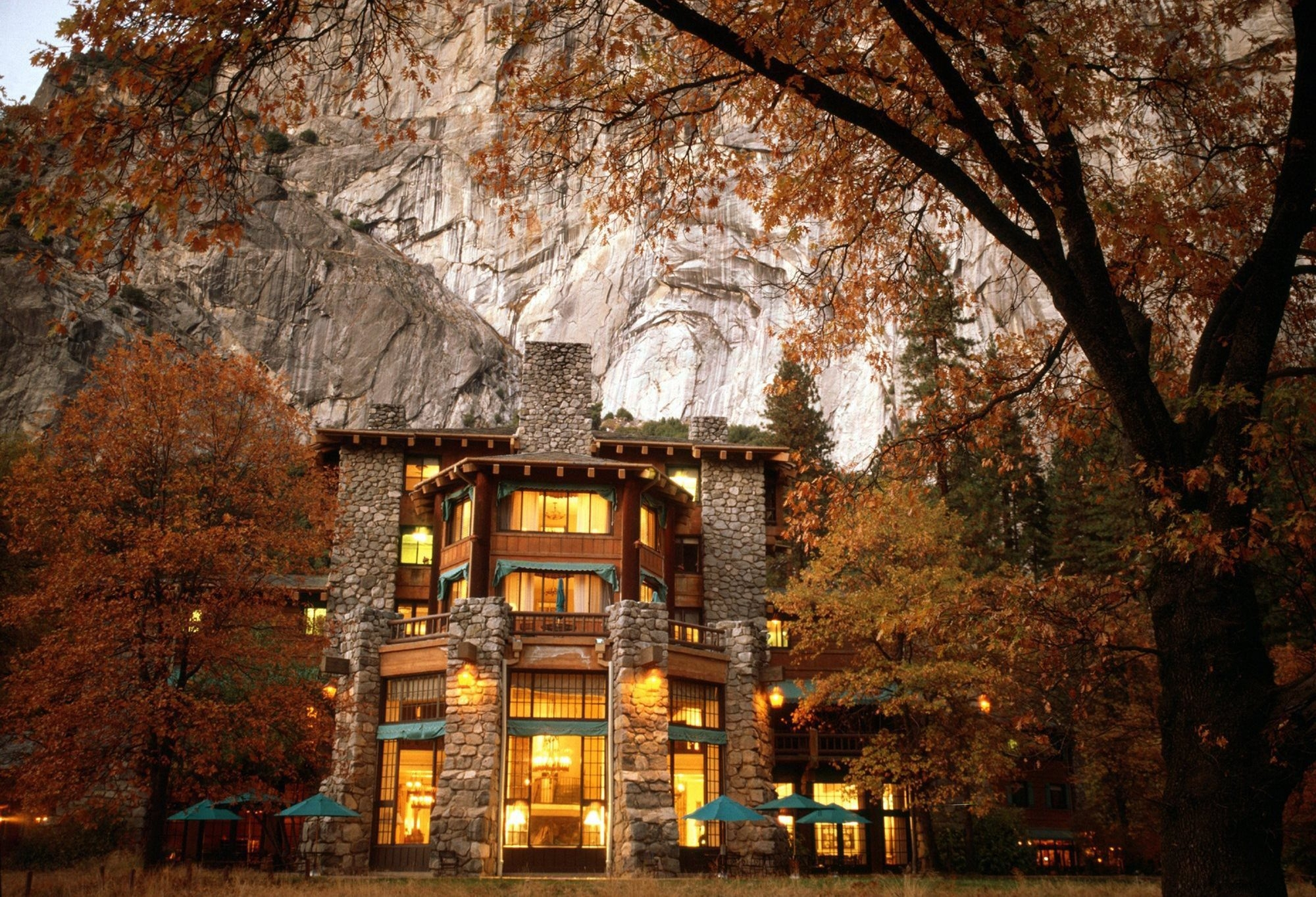 Ahwahnee Hotel in California's Yosemite National Park, a classic brand under hospitality giant Delaware North since 1993, is now the Majestic Yosemite Hotel under new concessionaire Aramark amid continuing legal dispute over trademark value.
