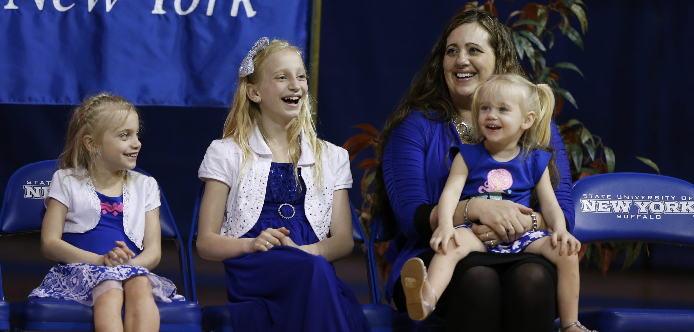 When Nate Oats was introduced as UB's men's basketball coach in 2015, his wife, Crystal, and daughters were on hand to cheer him on. (Harry Scull Jr./News file photo)