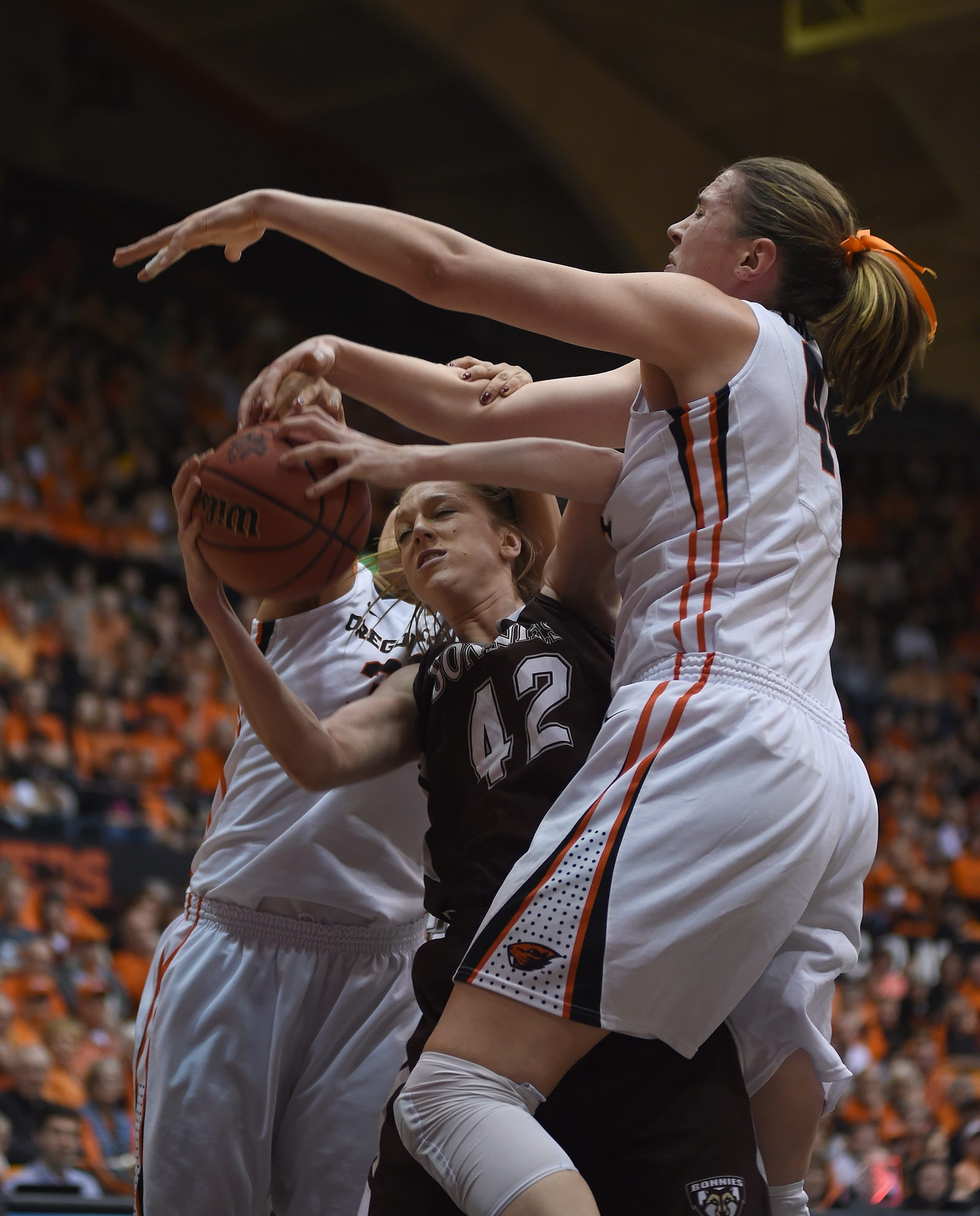 St. Bonaventure forward Katie Healy runs into a couple of Oregon State defenders when she tried to put up a shot in Sunday's NCAA tournament game.