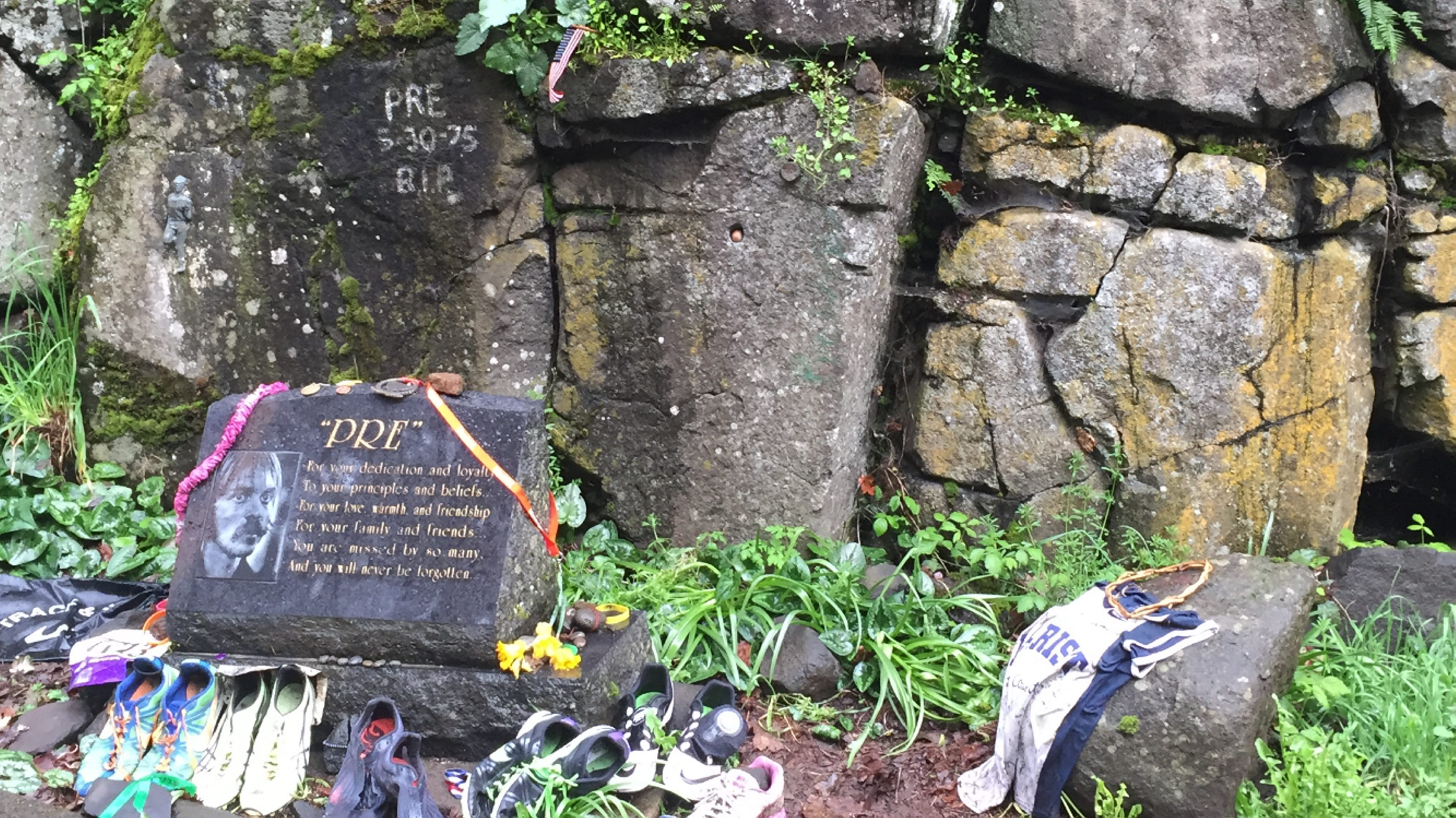 The scene of Steve Prefontaine's fatal car accident in Eugene, Ore., remains a shrine to runners. They have left behind sneakers, race bibs, medals and messages to honor him at Pre's Rock.