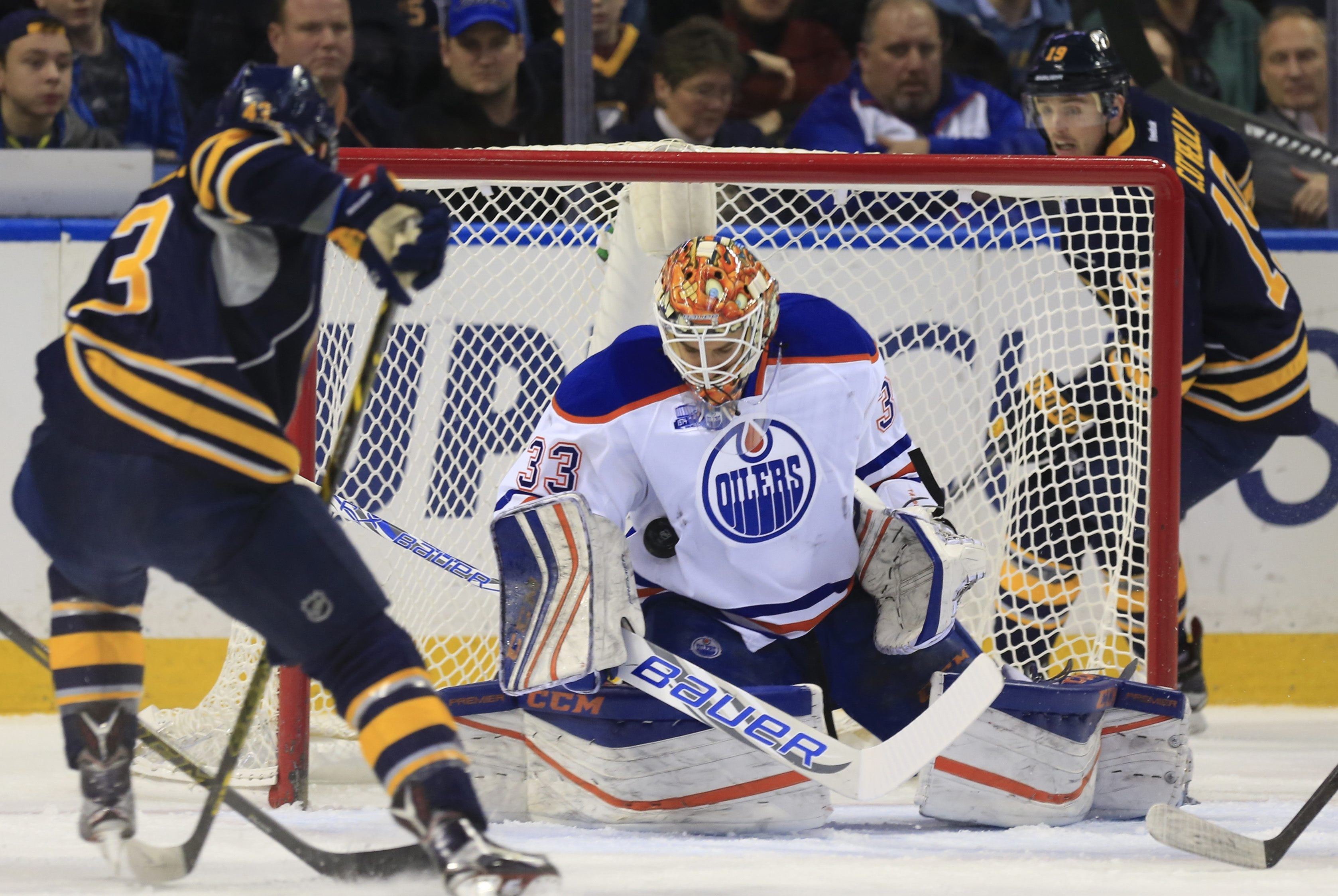 Edmonton goalie Cam Talbot stops the save against Daniel Catenacci of the Sabres in the first period of Tuesday night's game.