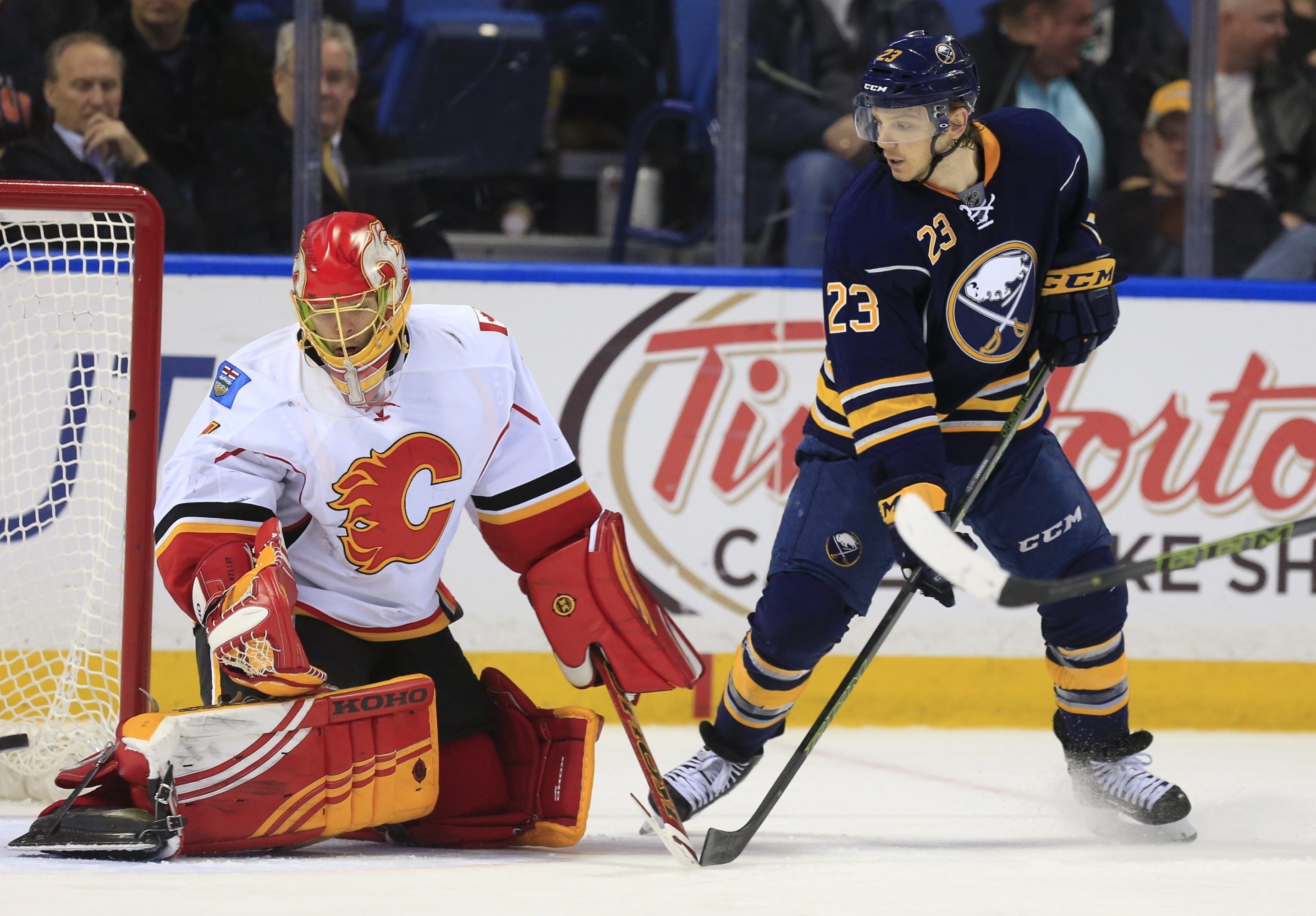 Buffalo's Sam Reinhart tips the puck in front of Calgary goaltender Jonas Hiller in the third period.
