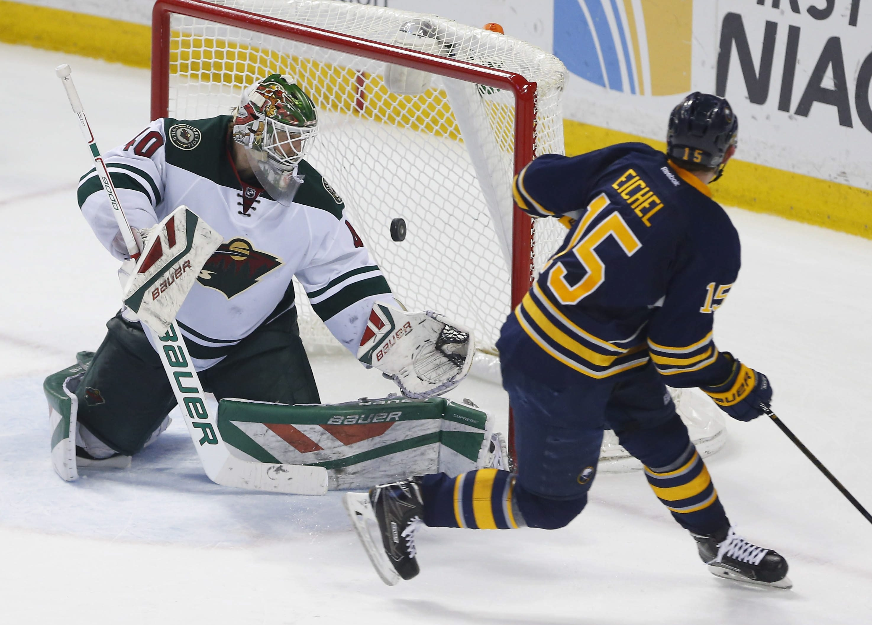 Buffalo Sabres center Jack Eichel puts the puck past Minnesota Wild  goaltender Devan Dubnyk in the shootout period at the First Niagara Center in Buffalo on Saturday.