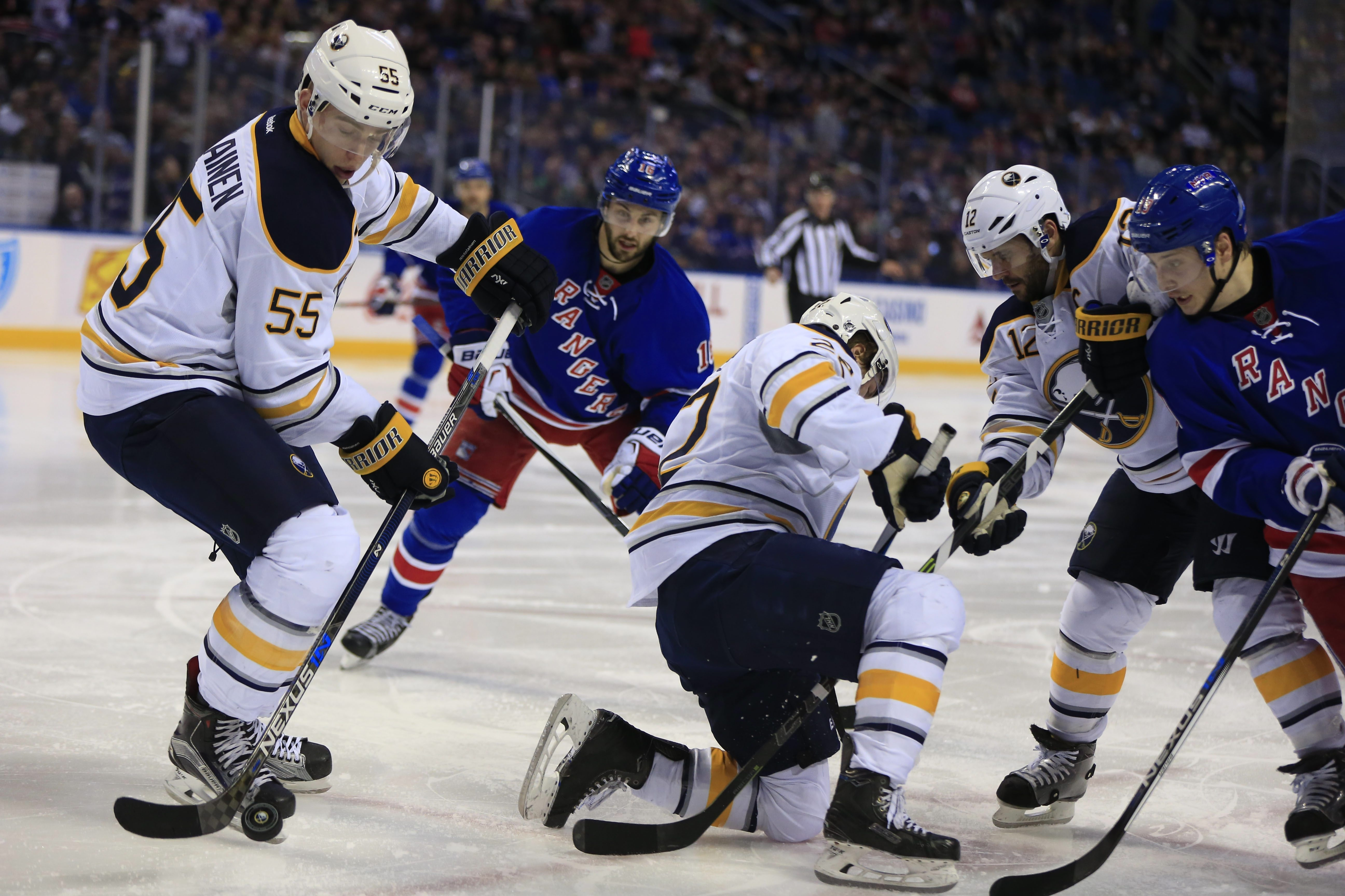 Defenseman Rasmus Ristolainen clears the puck against the New York Rangers during the second period of Tuesday's game.