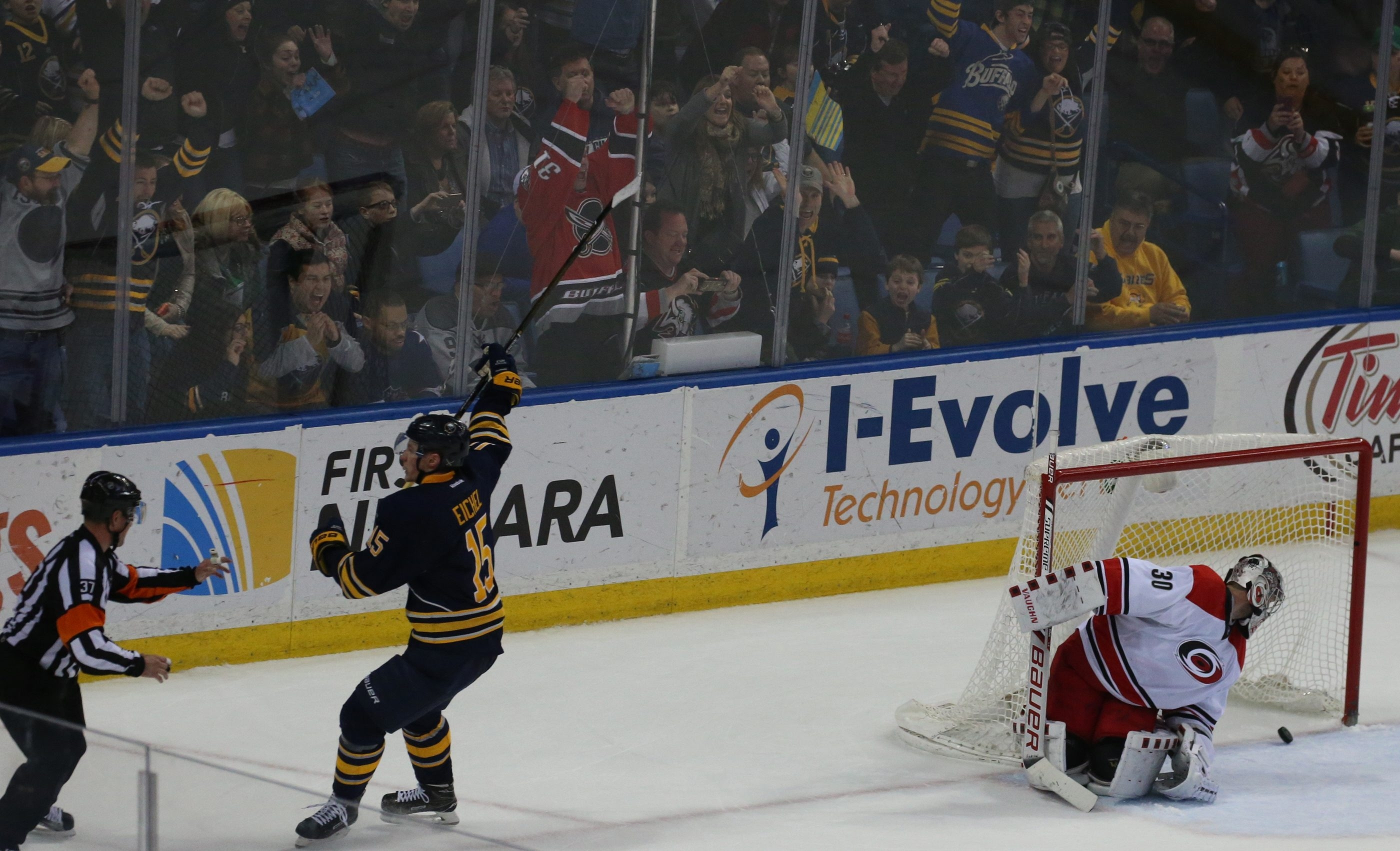 Buffalo's Jack Eichel celebrates as he scores the winning goal on Carolina's Cam Ward in overtime at First Niagara Center.
