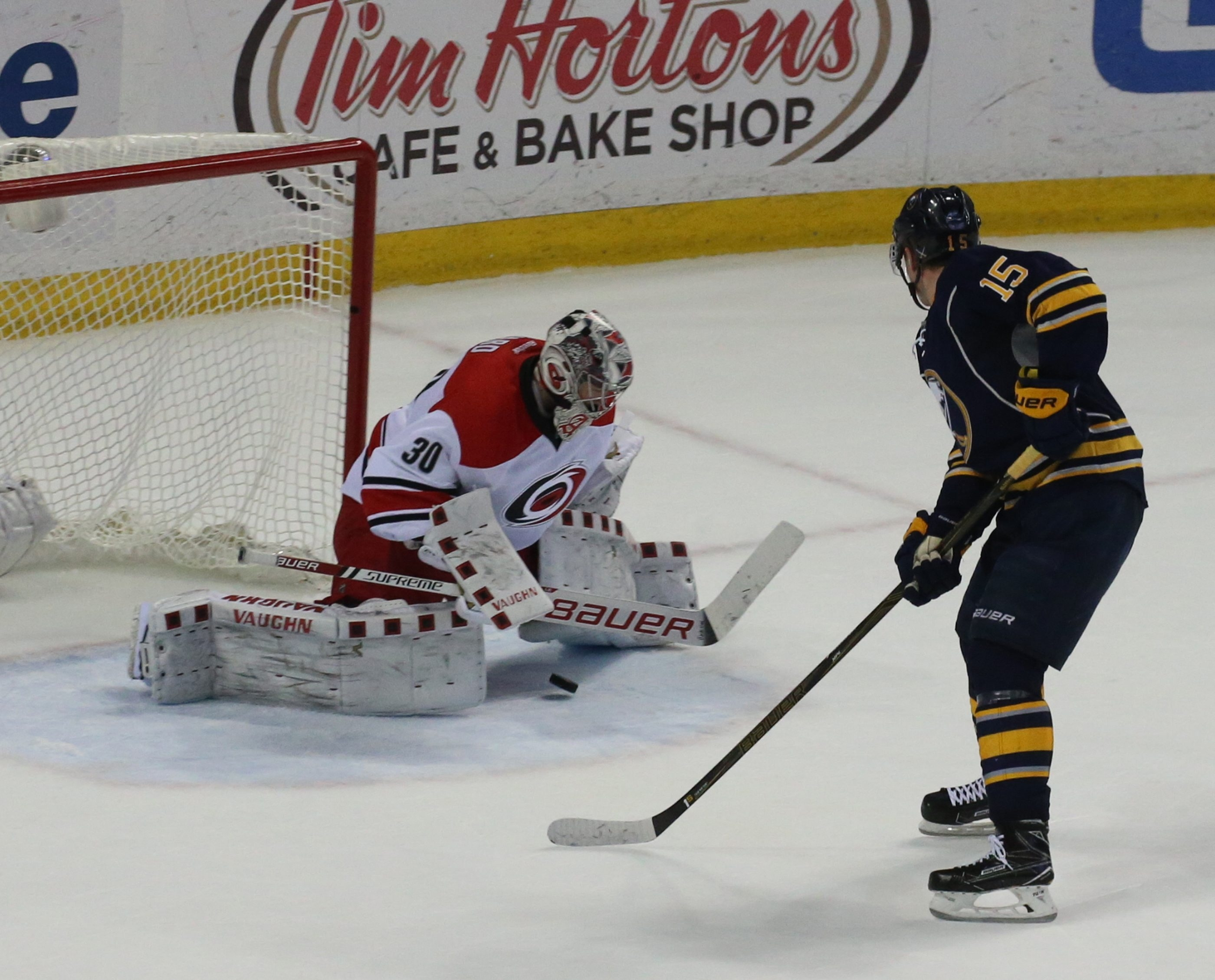 Jack Eichel scores the winning goal for the Sabres against Carolina's Cam Ward after a spectacular pass from Evander Kane.