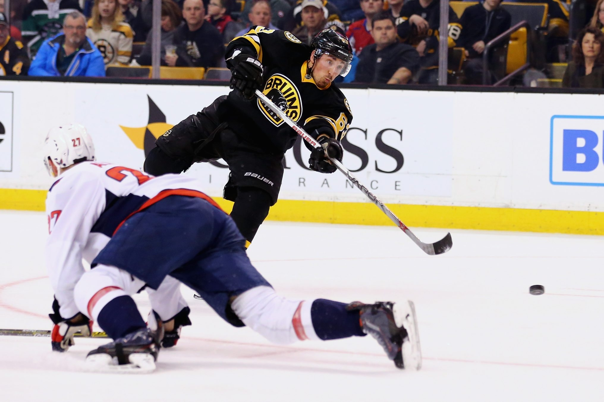 BOSTON, MA - MARCH 05:  Brad Marchand #63 of the Boston Bruins takes a shot against the Washington Capitals during the third period at TD Garden on March 5, 2016 in Boston, Massachusetts.  (Photo by Maddie Meyer/Getty Images)