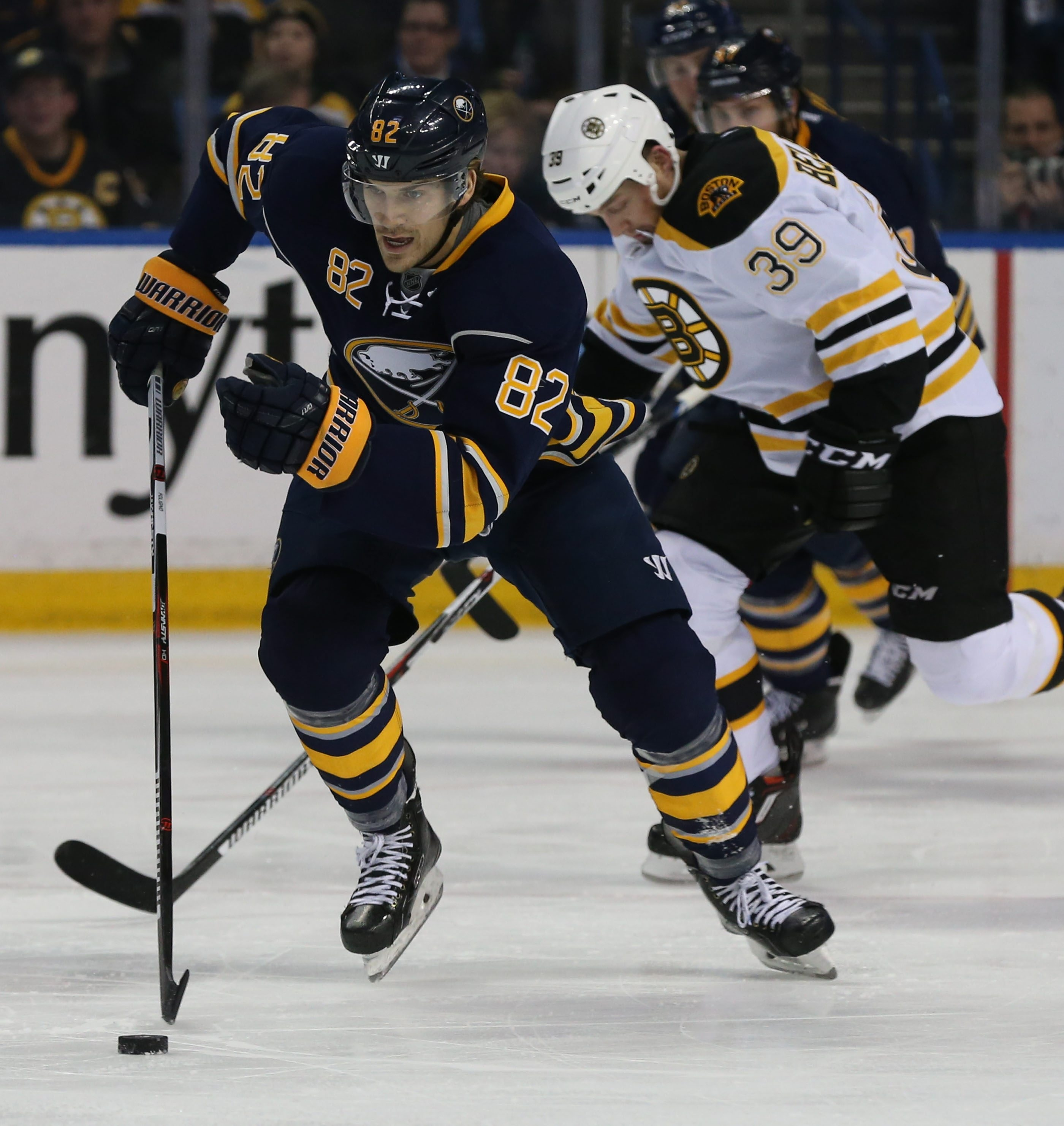 Marcus Foligno (82) battles Boston Bruins left wing Matt Beleskey (39) for the puck in the first period at First Niagara Center in Buffalo, NY on Friday, Jan. 15, 2016.  (James P. McCoy/ Buffalo News)