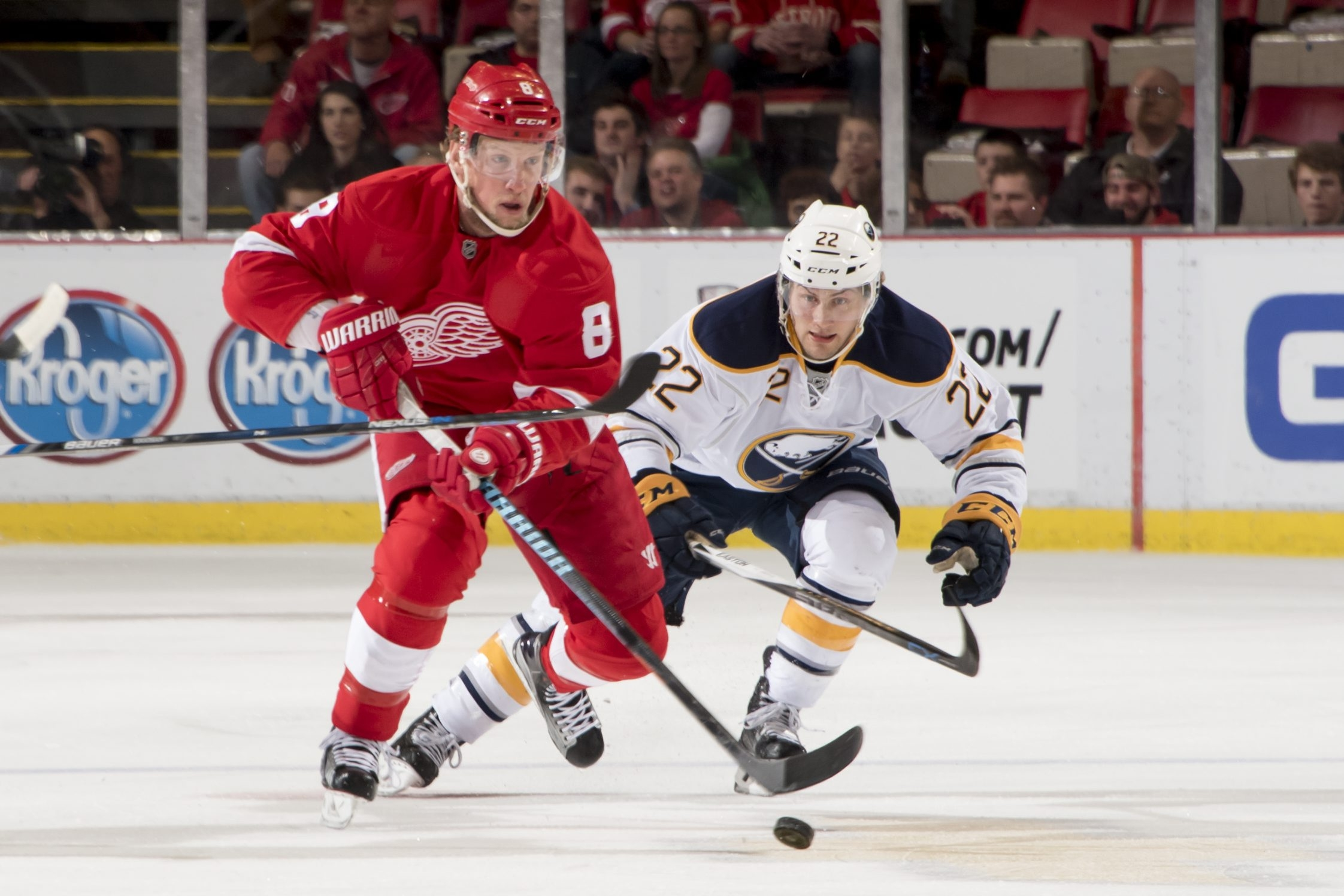 Detroit's Justin Abdelkader and Buffalo's Johan Larsson battle for the puck during the first period at Joe Louis Arena.