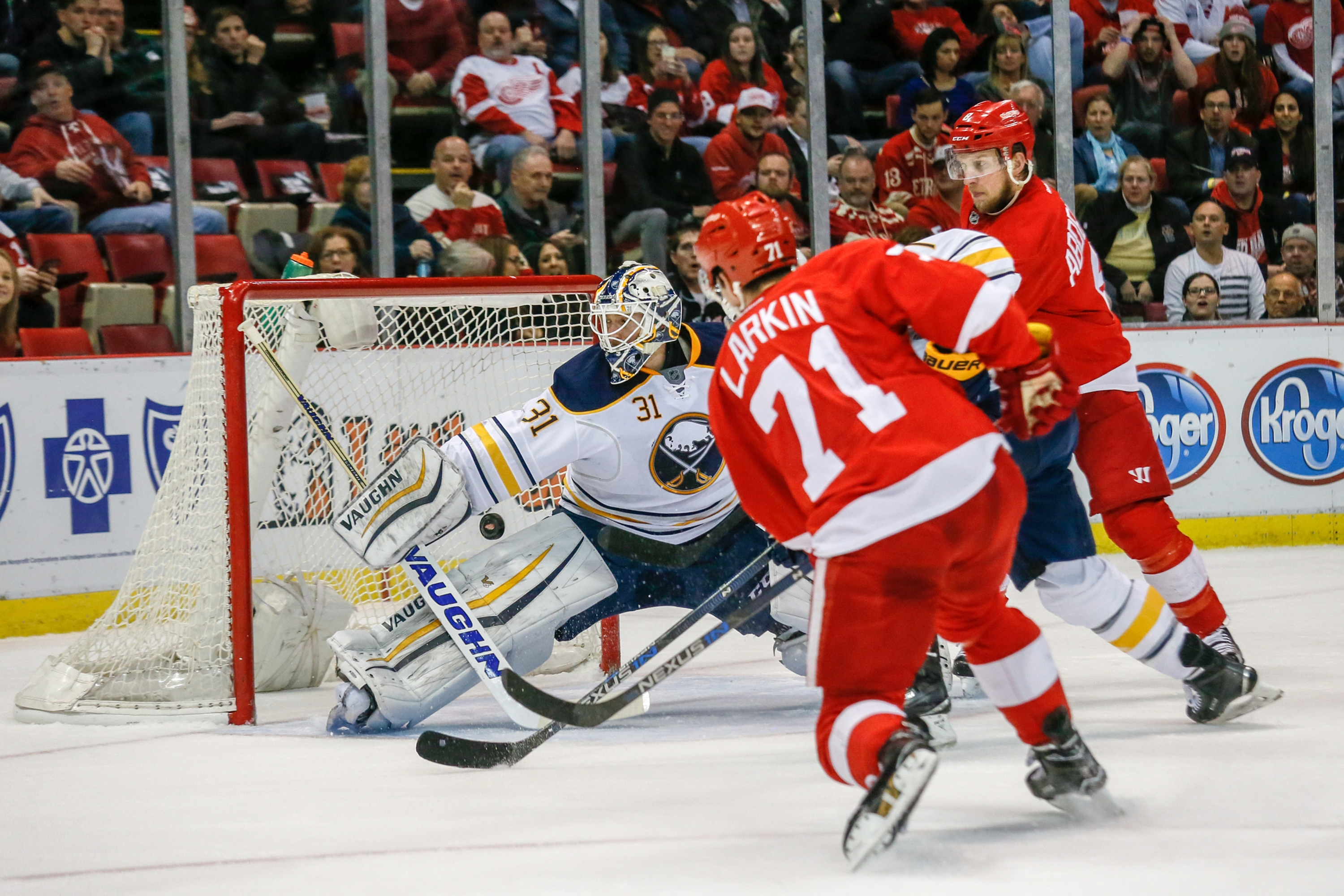 Detroit Red Wings' Dylan Larkin scores a goal on Buffalo Sabres goalie Chad Johnson during the first period. (Tribune News Service)