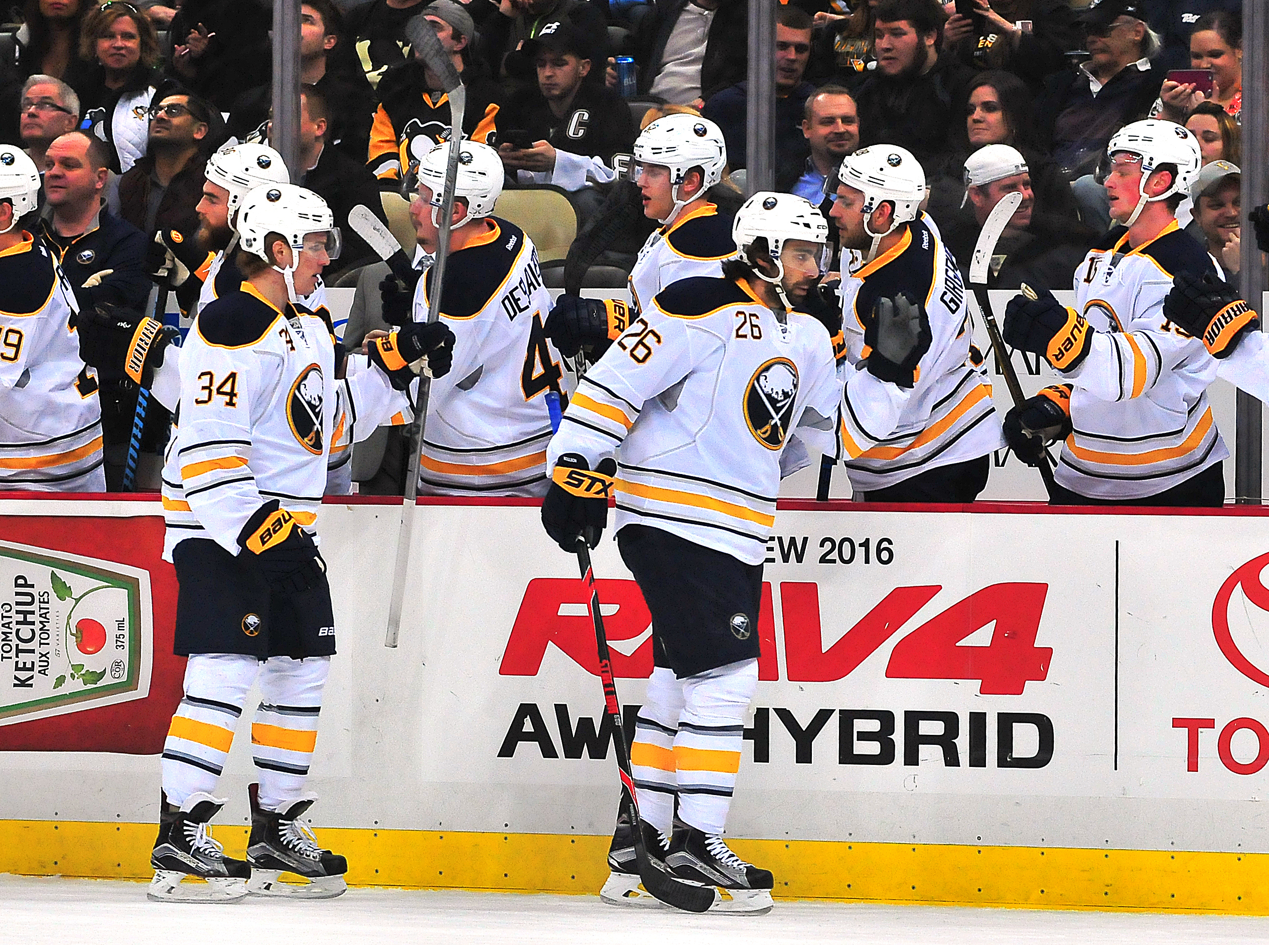 Matt Moulson (26) is congratulated by his Sabres teammates after scoring a goal against Pittsburgh. (Getty Images)
