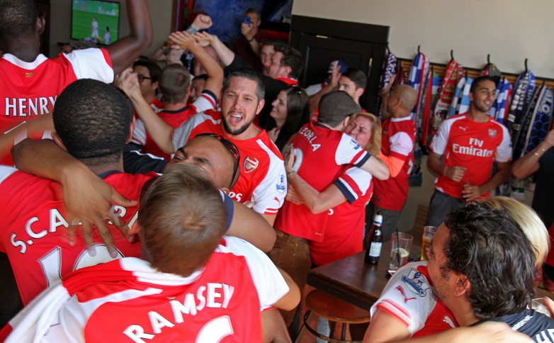 Arsenal FC fans celebrate a goal in Mes Que in 2014. (Erica Malinowski/Special to The News)