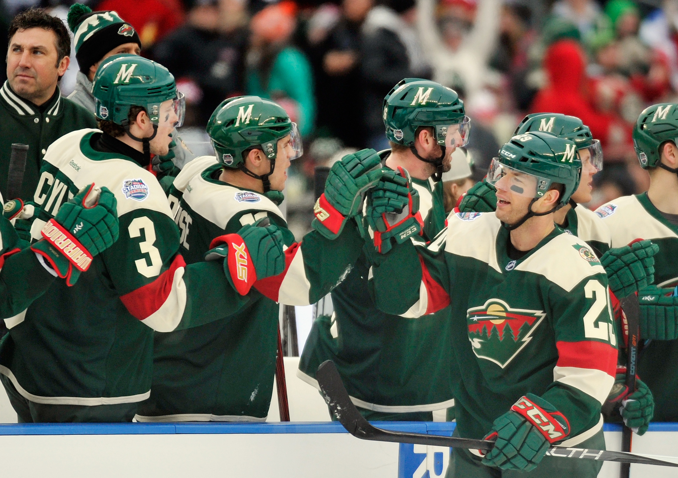 Jason Pominville (right) celebrates his goal for the Wild during the team's outdoor game at TCF Bank Stadium on  Feb. 21 (Getty Images).